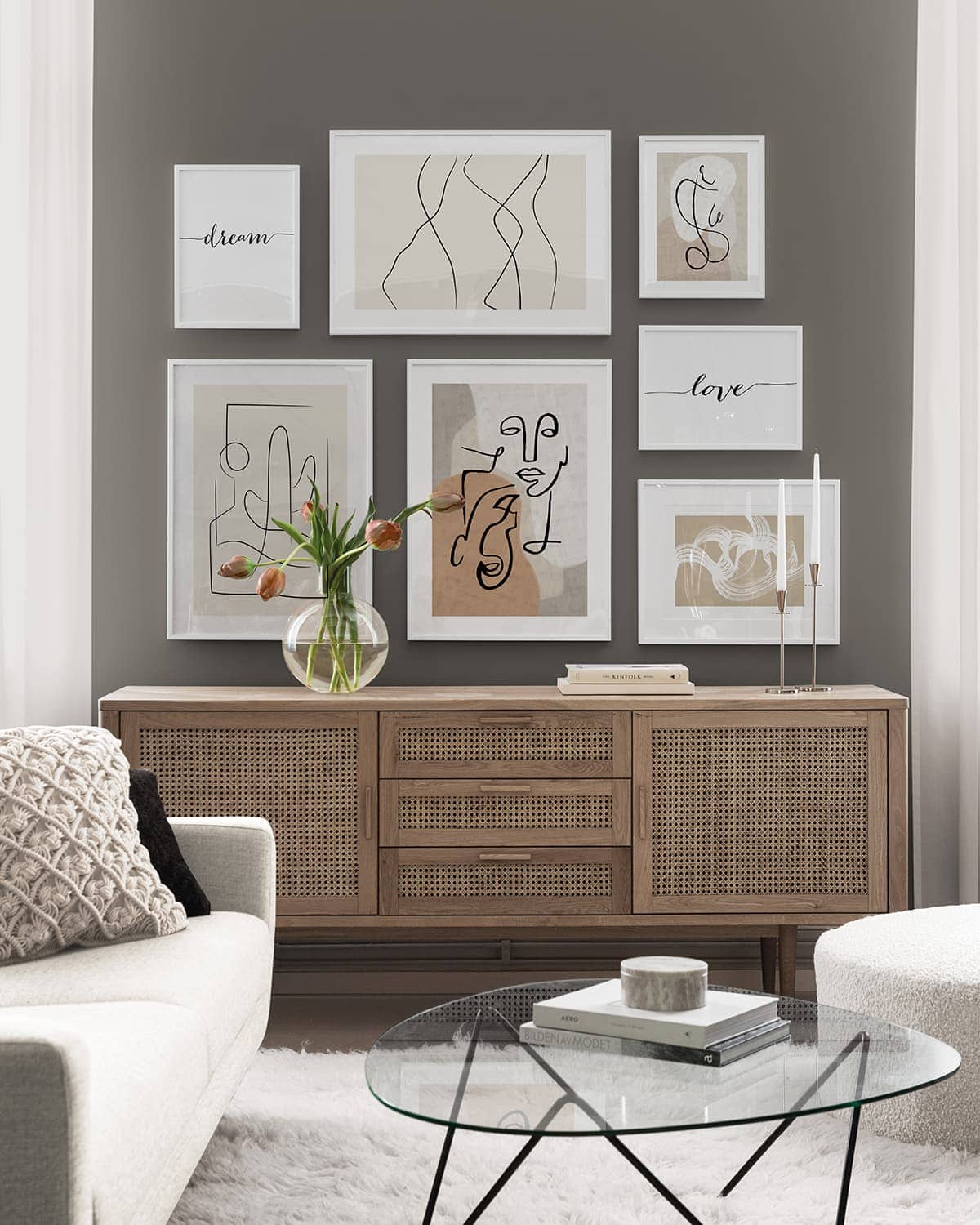 desenio minimalist artworks gallery wall on olive green wall in living room with rattan sideboard