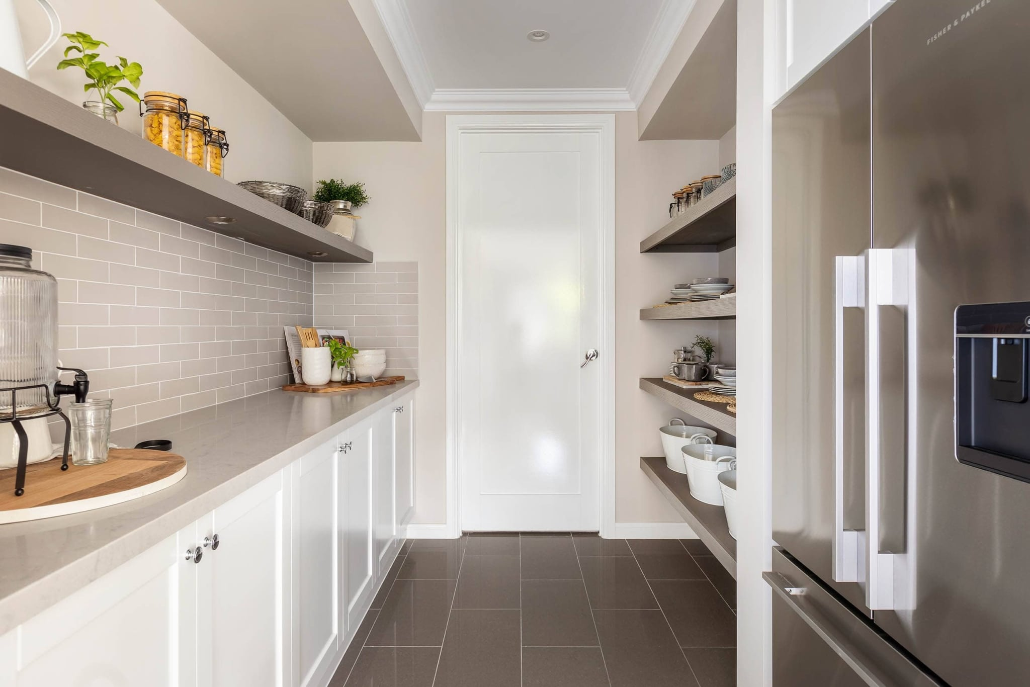 metricon butlers pantry with grey subway tiles and thick floating shelves shaker cabinets
