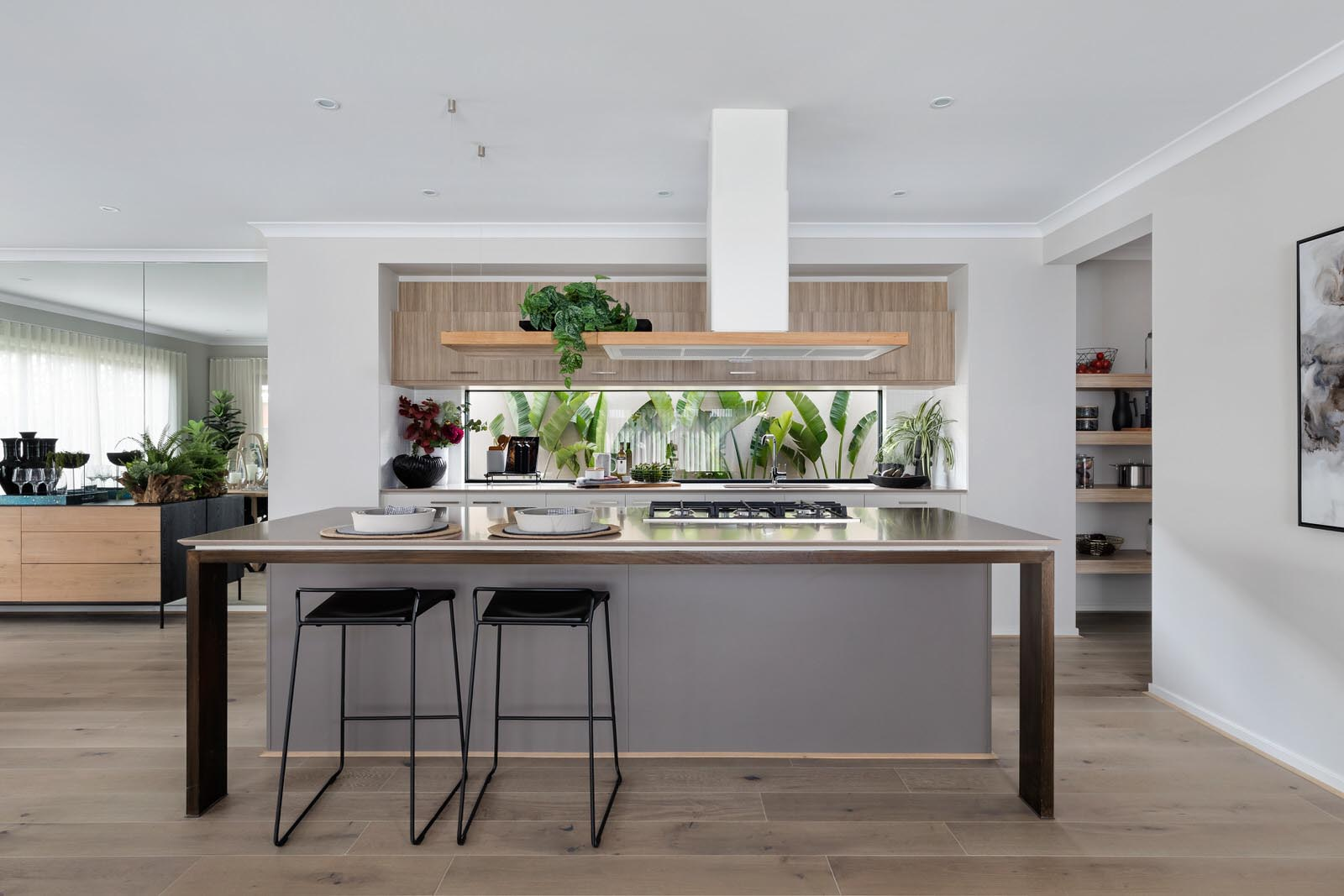 metricon kitchen with cooktop in island and light timber upper cabinets