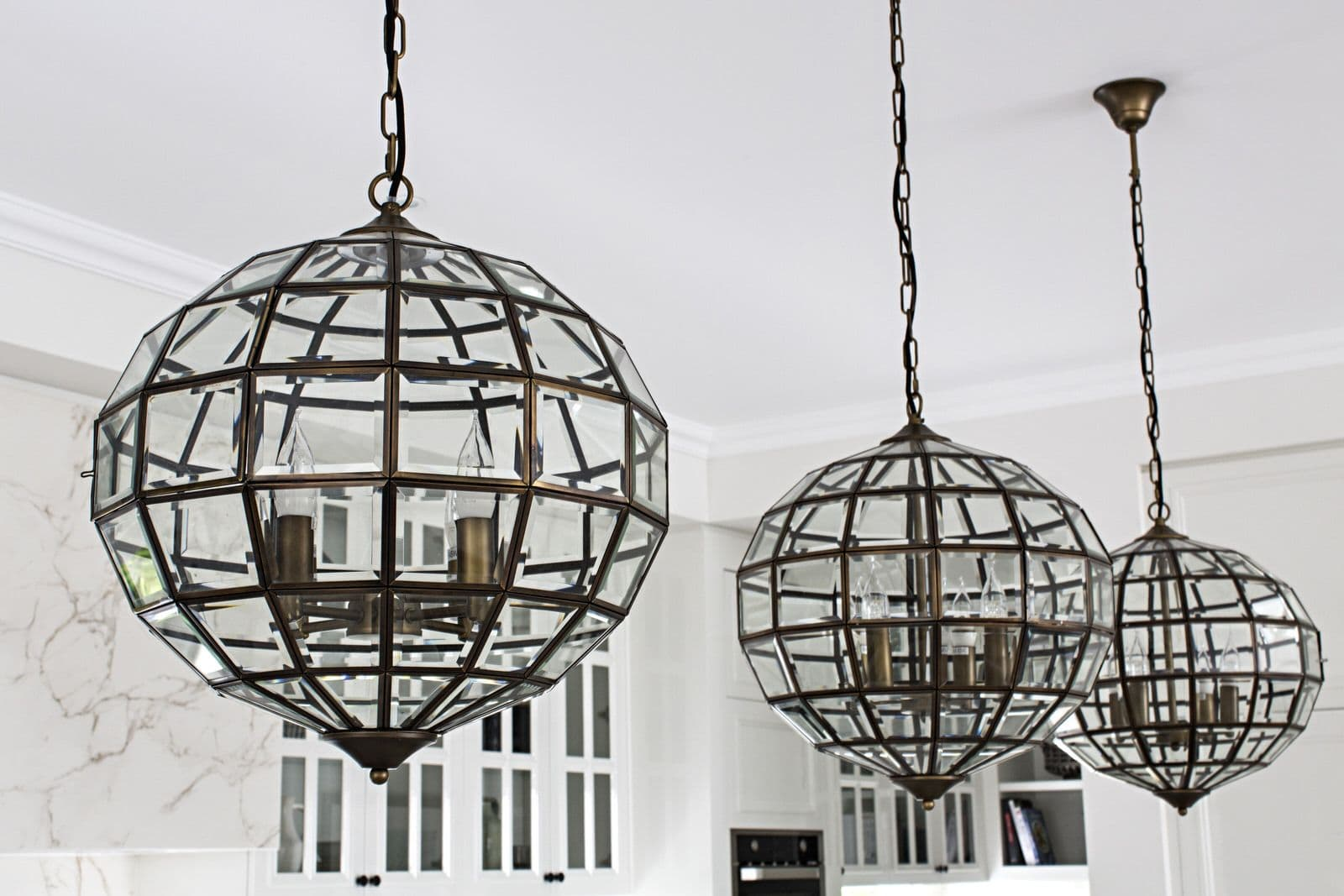 metricon la pyrenee kitchen pendant lights large round glass and metal art deco lights