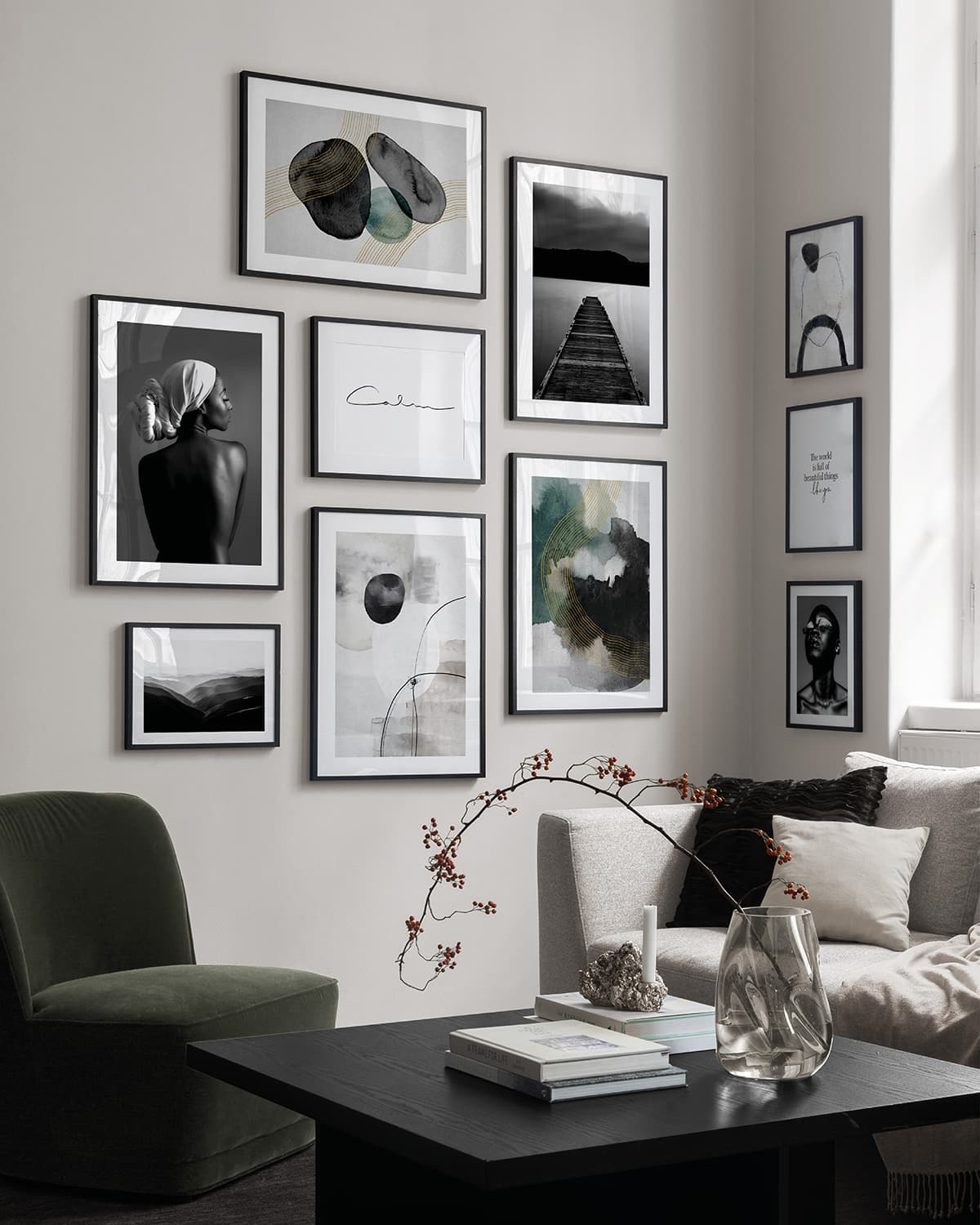 think black frame gallery wall with black and white desenio artworks wrapping around corner