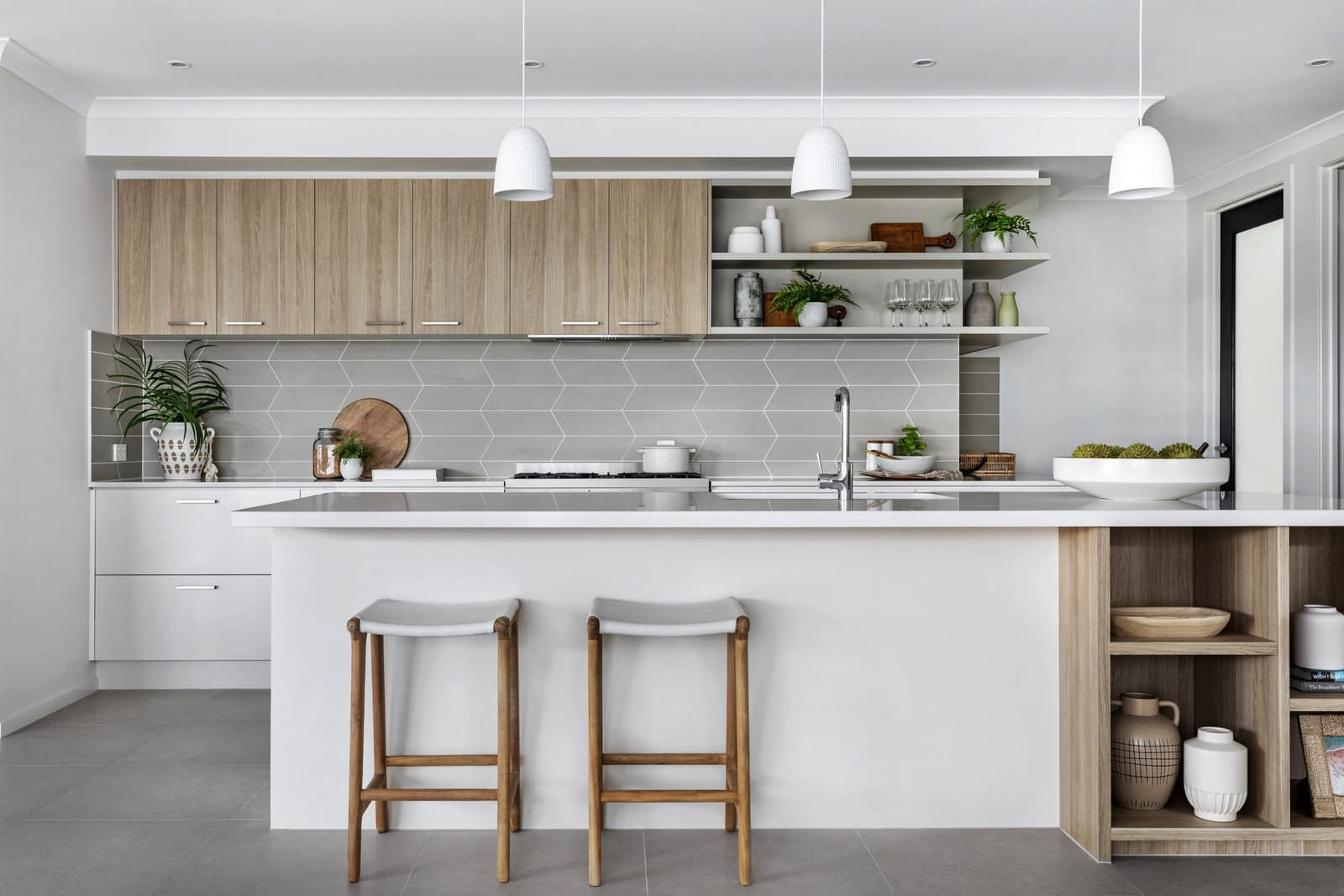 white and oak kitchen design with light grey geometric splashback tiles metricon homes