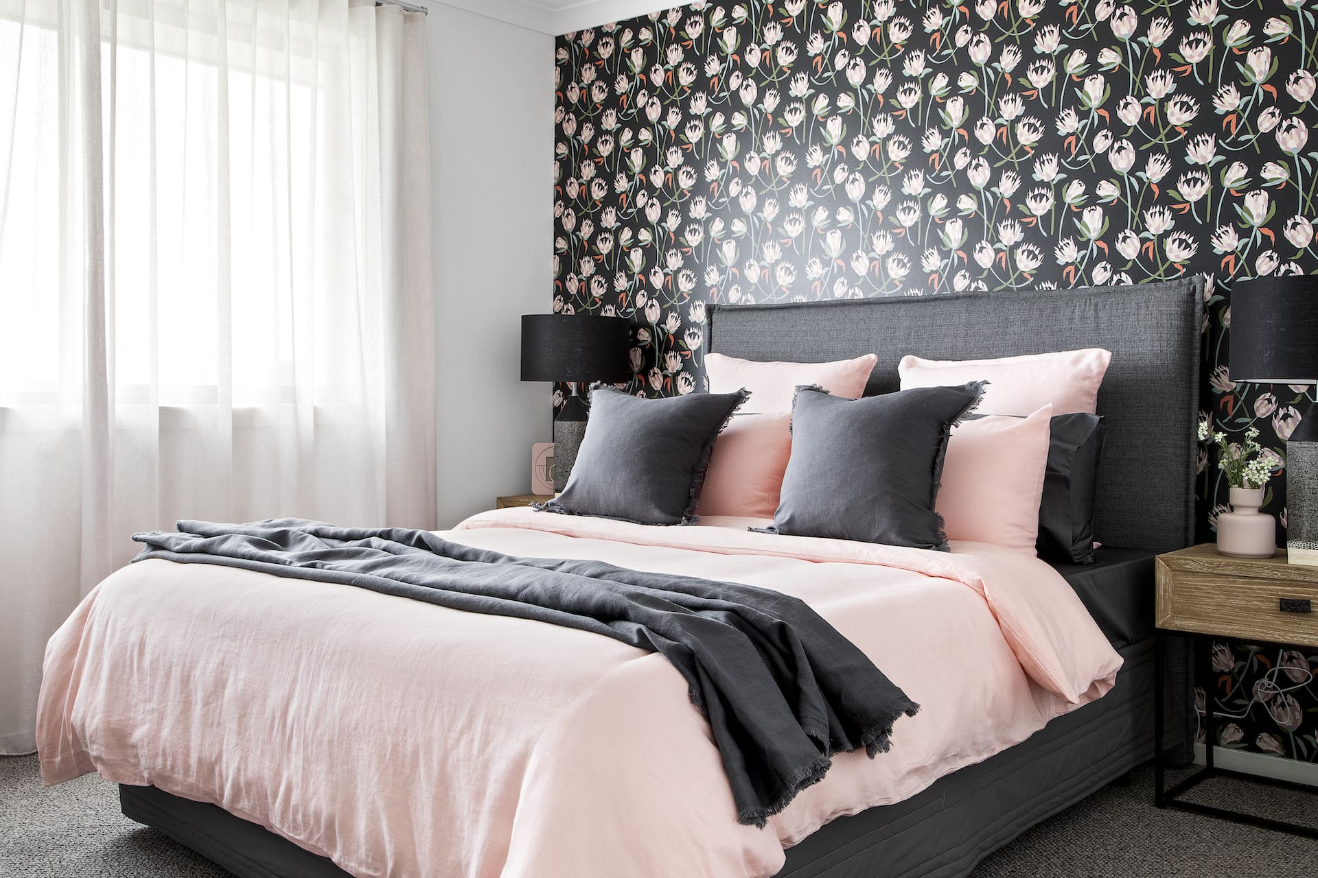 bedroom with pink quilt cover set and black and pink floral wallpaper australiana theme
