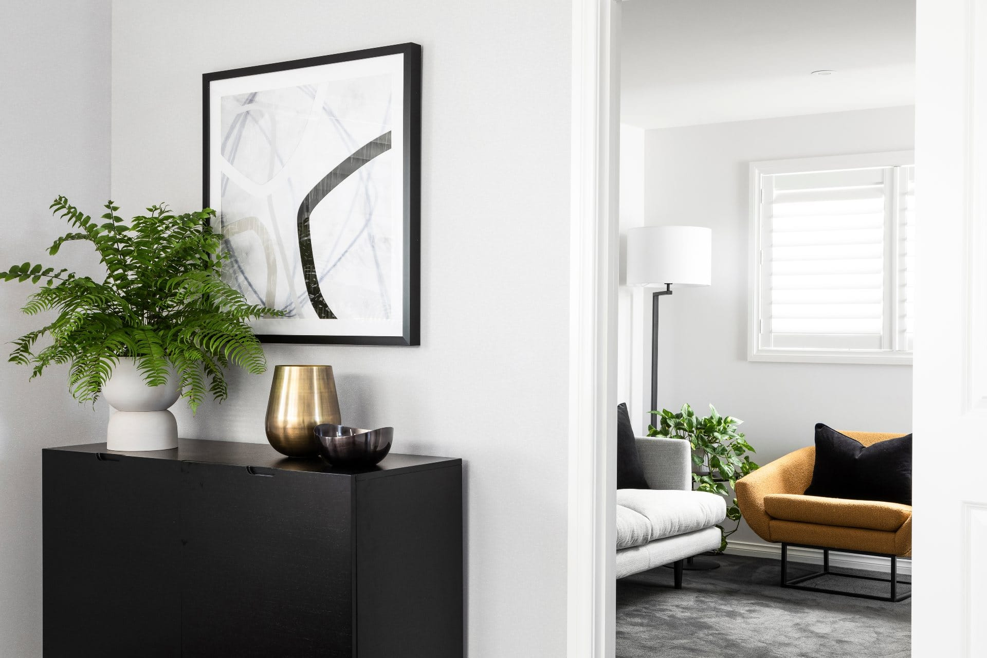 black luxe sideboard from brosa with mustard armchair from horgans in chic master bedroom