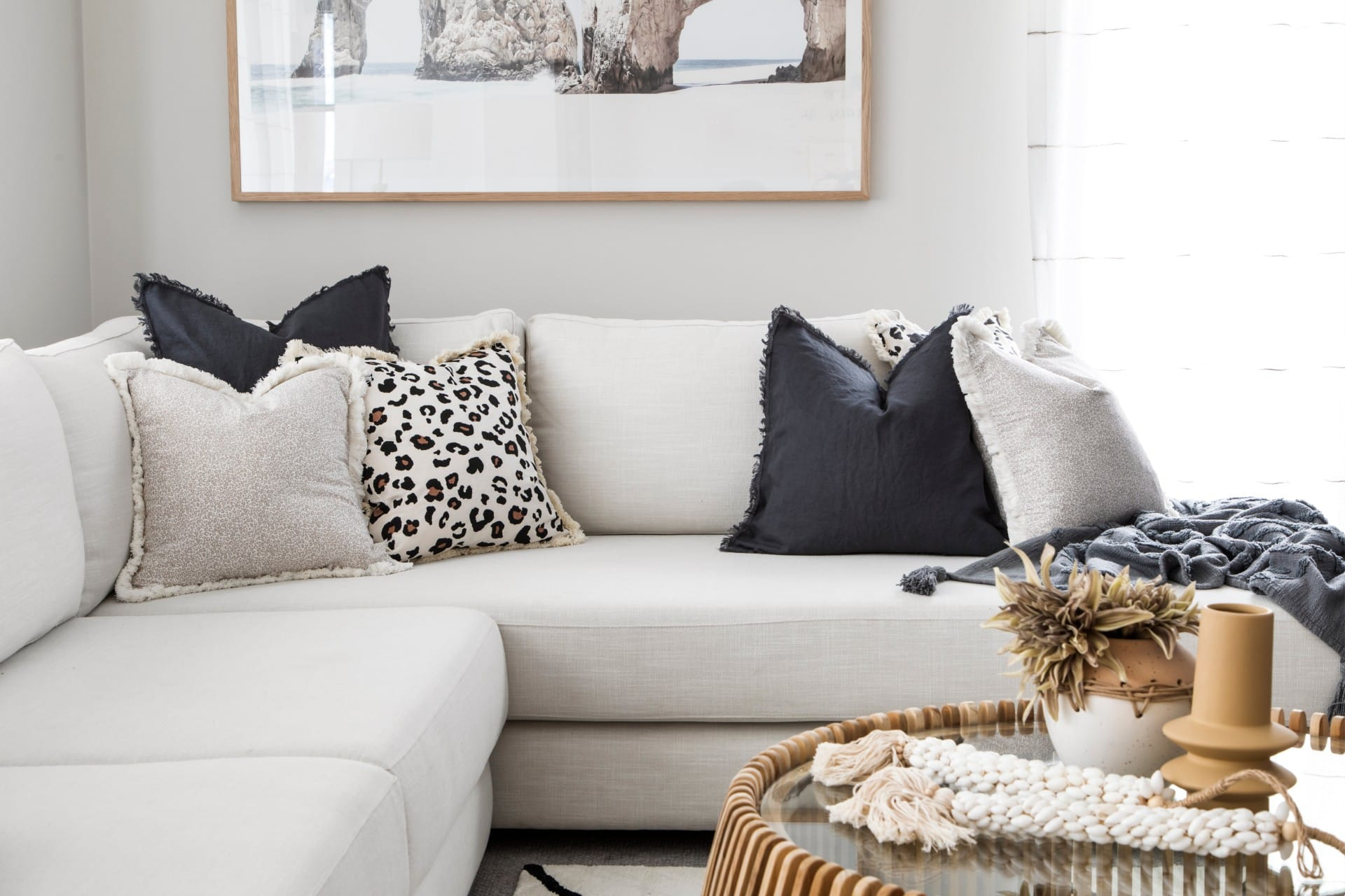 cream sectional sofa with leopard print cushions and coastal styling