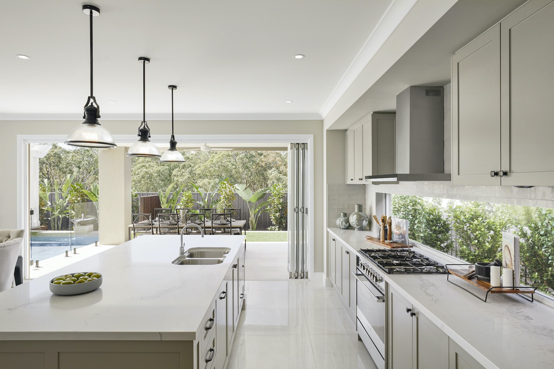 french provincial kitchen with grey shaker cabinets and industrial kitchen pendant lights