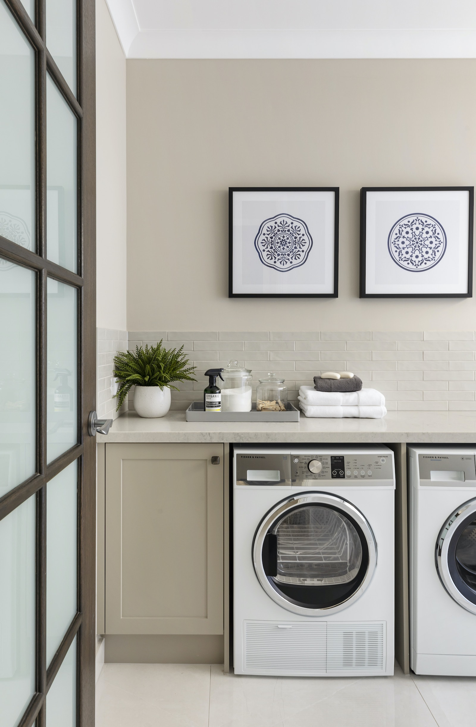 modern provincial laundry room with grey shaker cabinets and white stone countertop