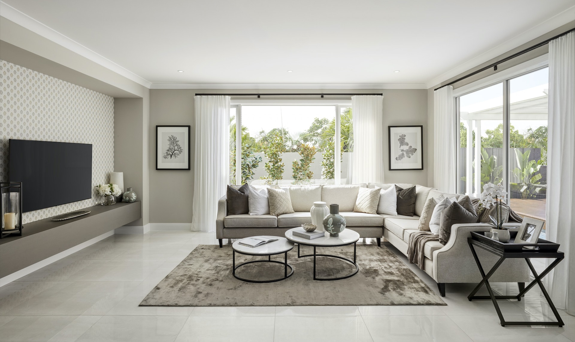 modern provincial living room design with cream sectional sofa and grey rug