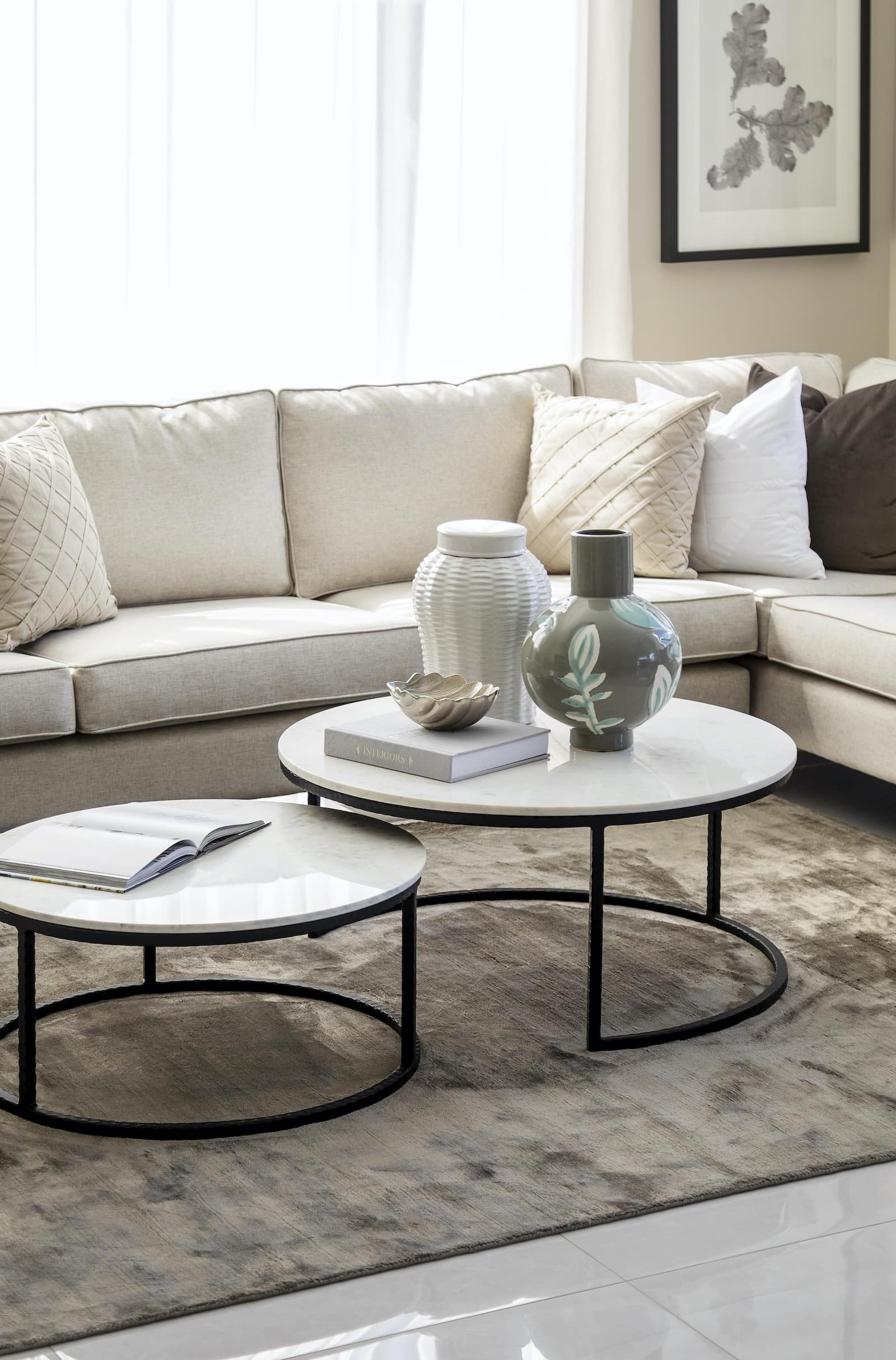 modern provincial living room design with round marble nesting coffee tables black legs