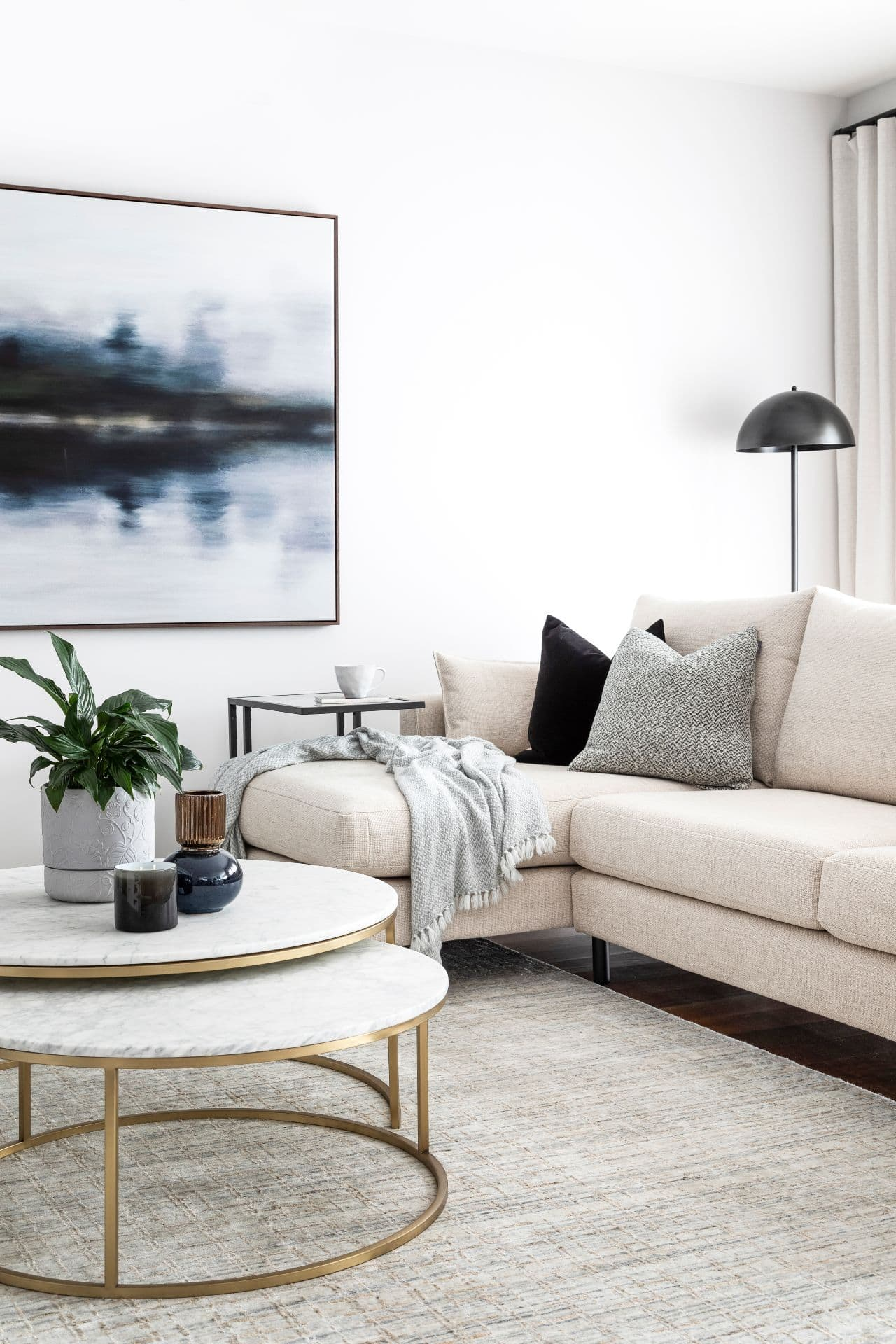 monochromatic living room design with gold leg marble coffee table from globewest