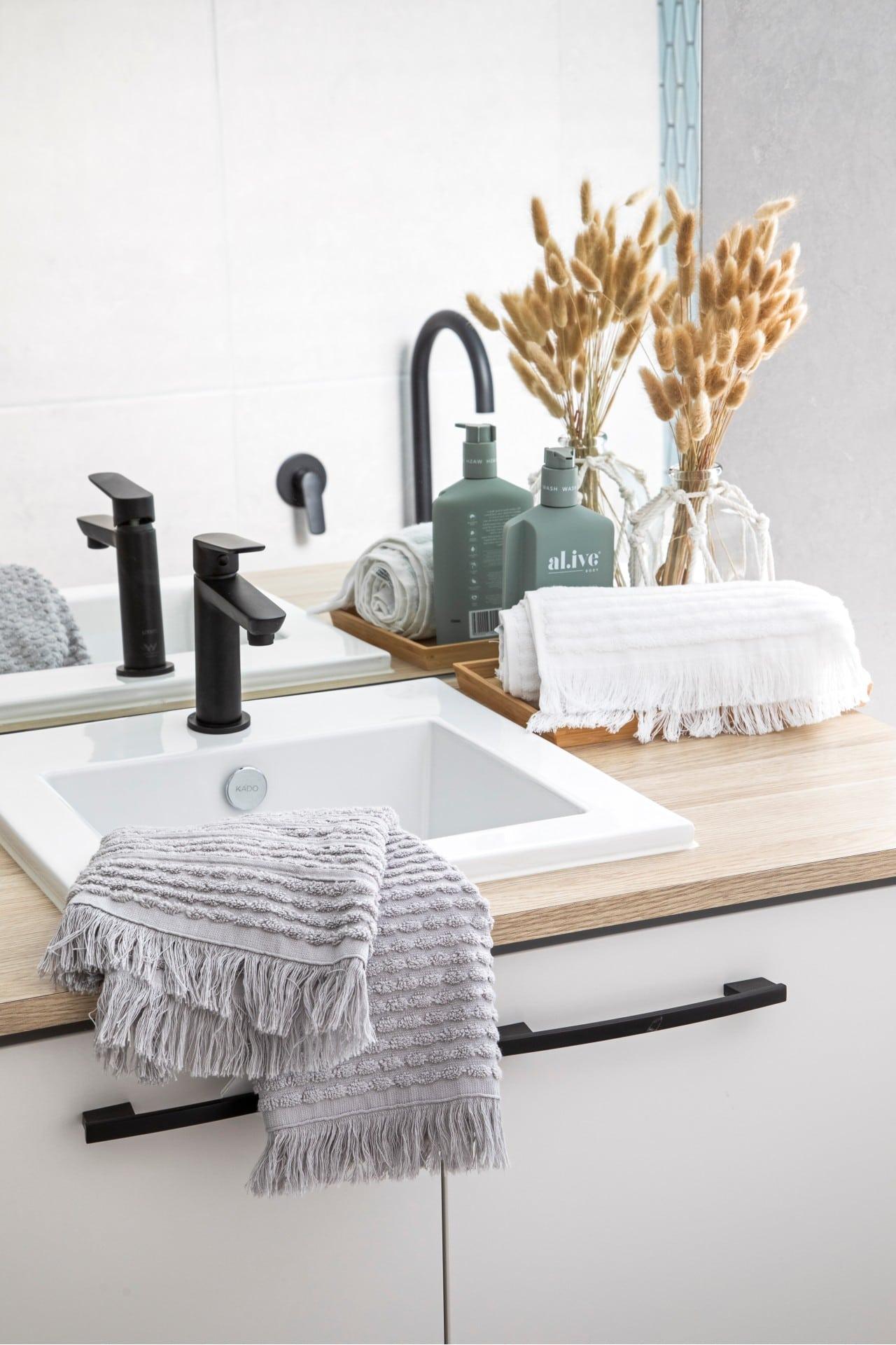 neutral bathroom timber top vanity white basin matt black bathroom tap grey fringe towel