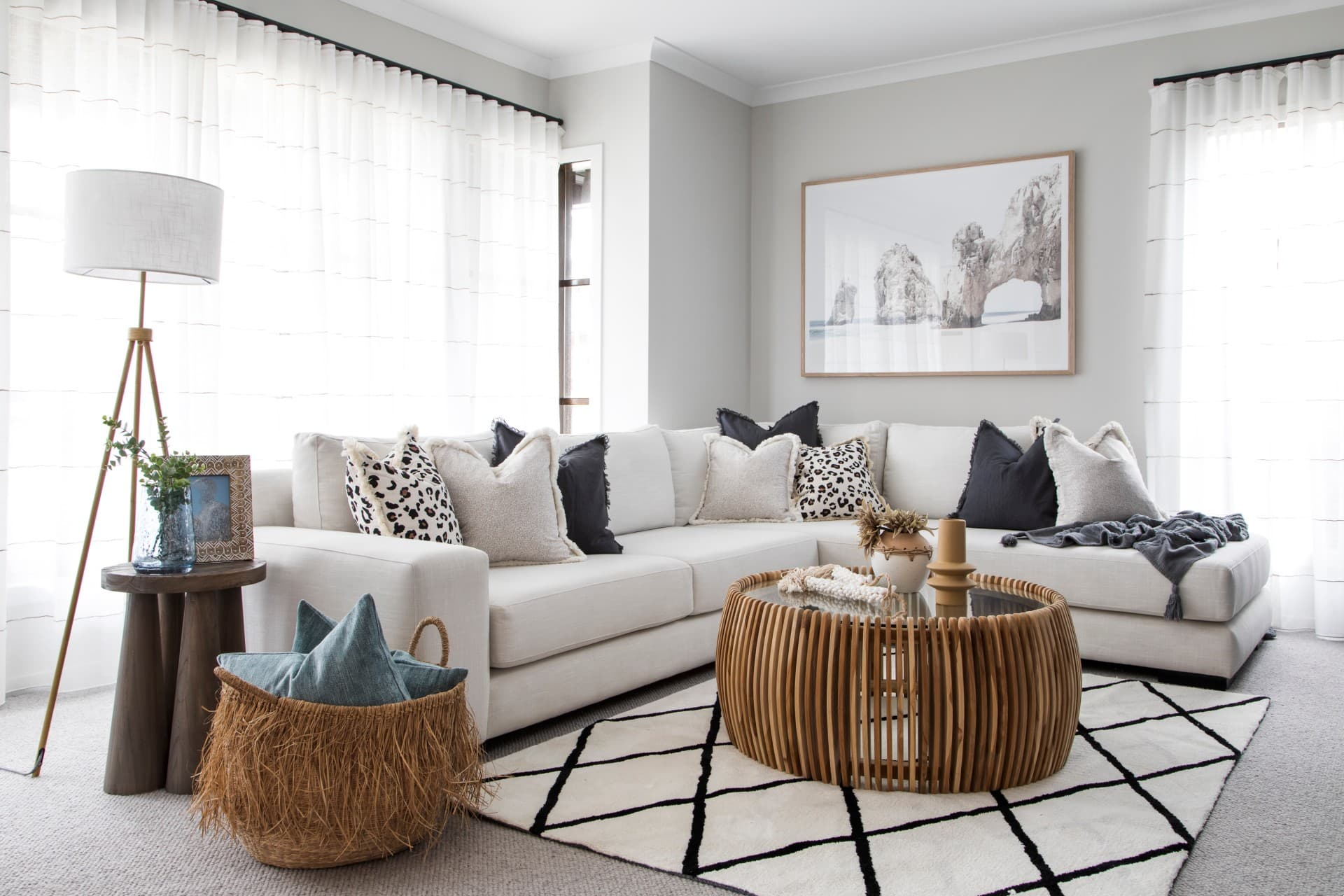neutral living room with diamond rug cream sectional sofa and leopard print cushions