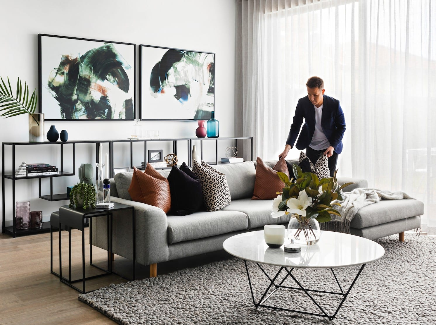 chris carroll melbourne interior designer in client living room with modern luxe design