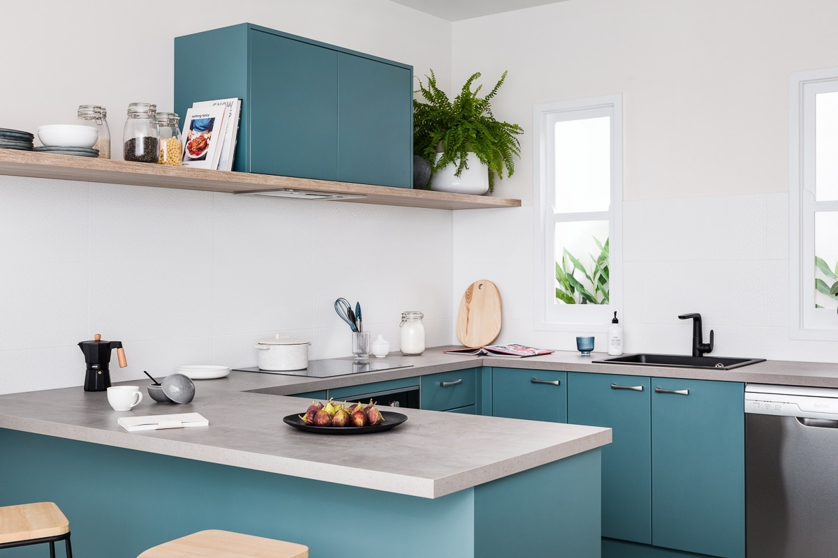 dark teal coloured kitchen cabinets with grey concrete countertop kaboodle kitchens