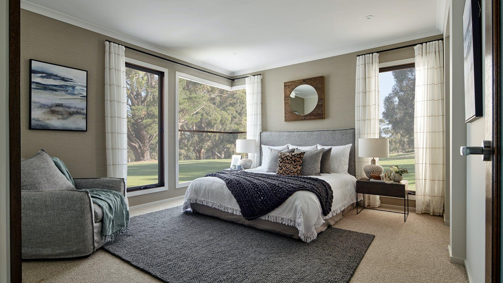 centre open striped sheer curtains on black track in master bedroom
