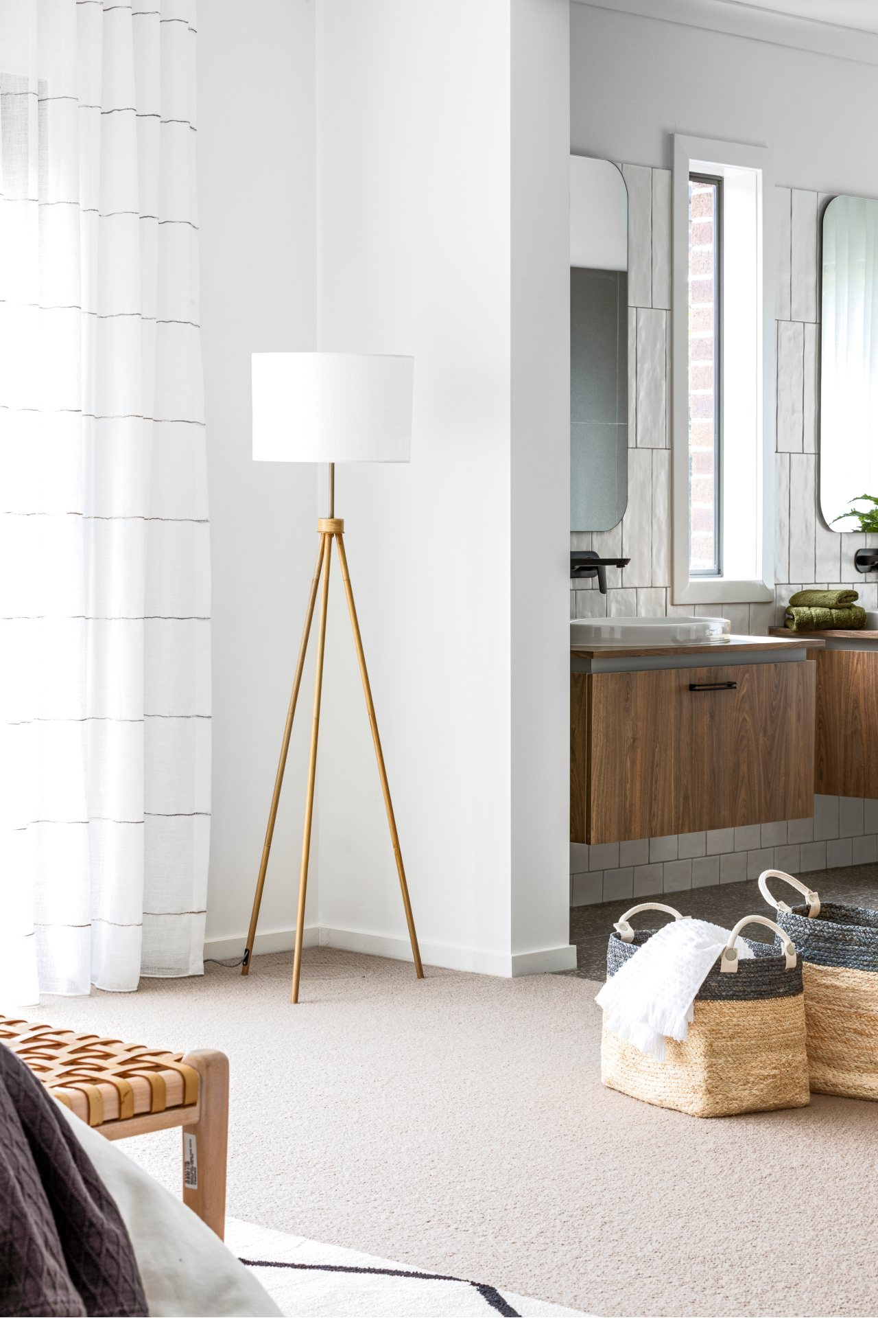coastal three leg floor lamp with round white shade ensuite with brown timber floating vanity