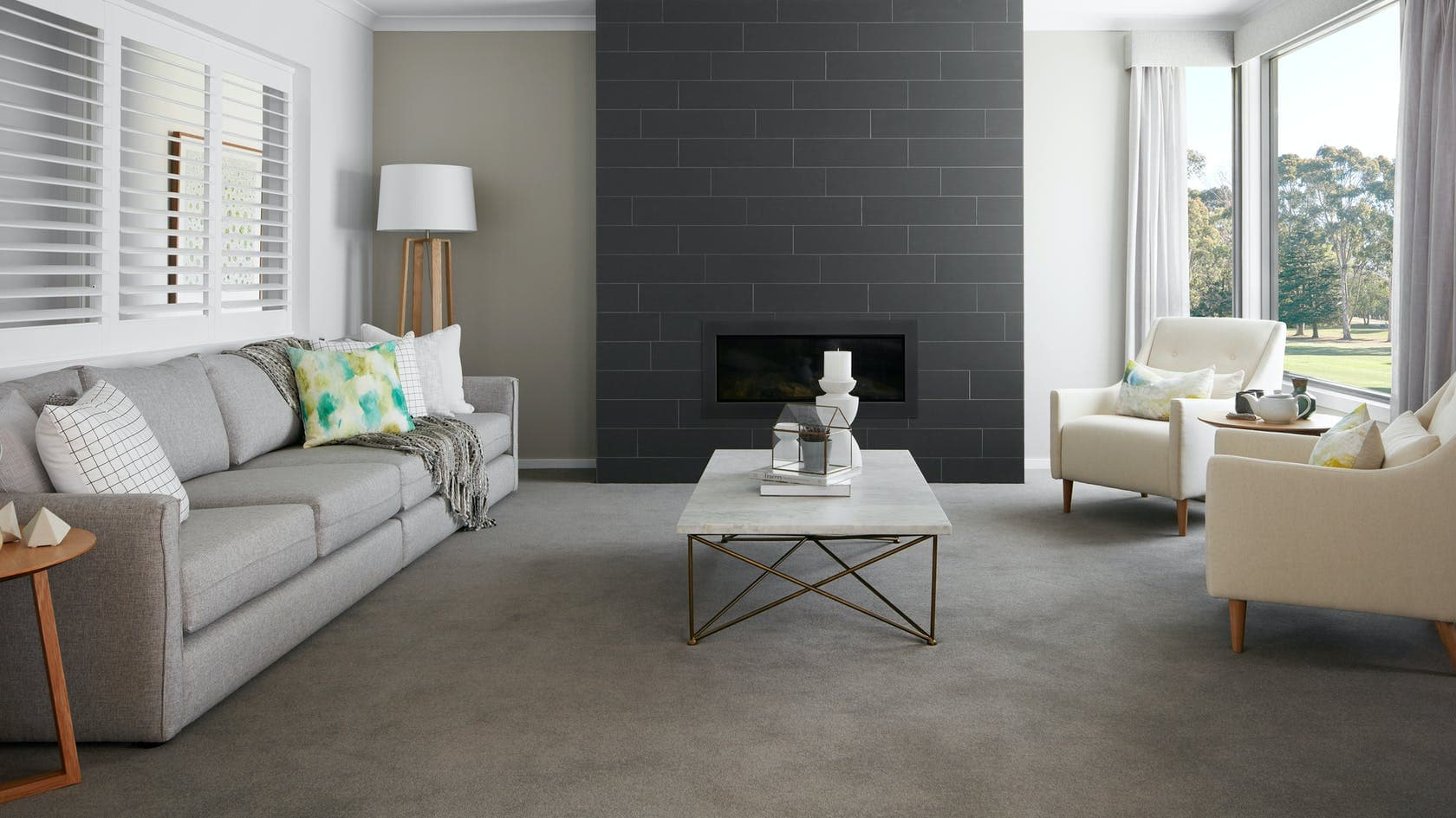 formal living room design with black tile fireplace and conversation pit