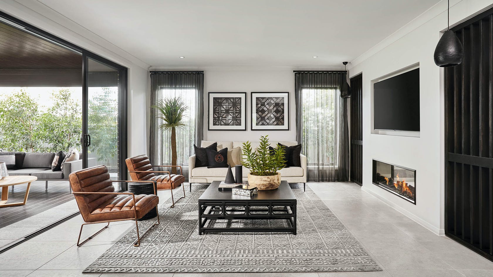 formal living room design with horizontal fireplace and tv mounted above