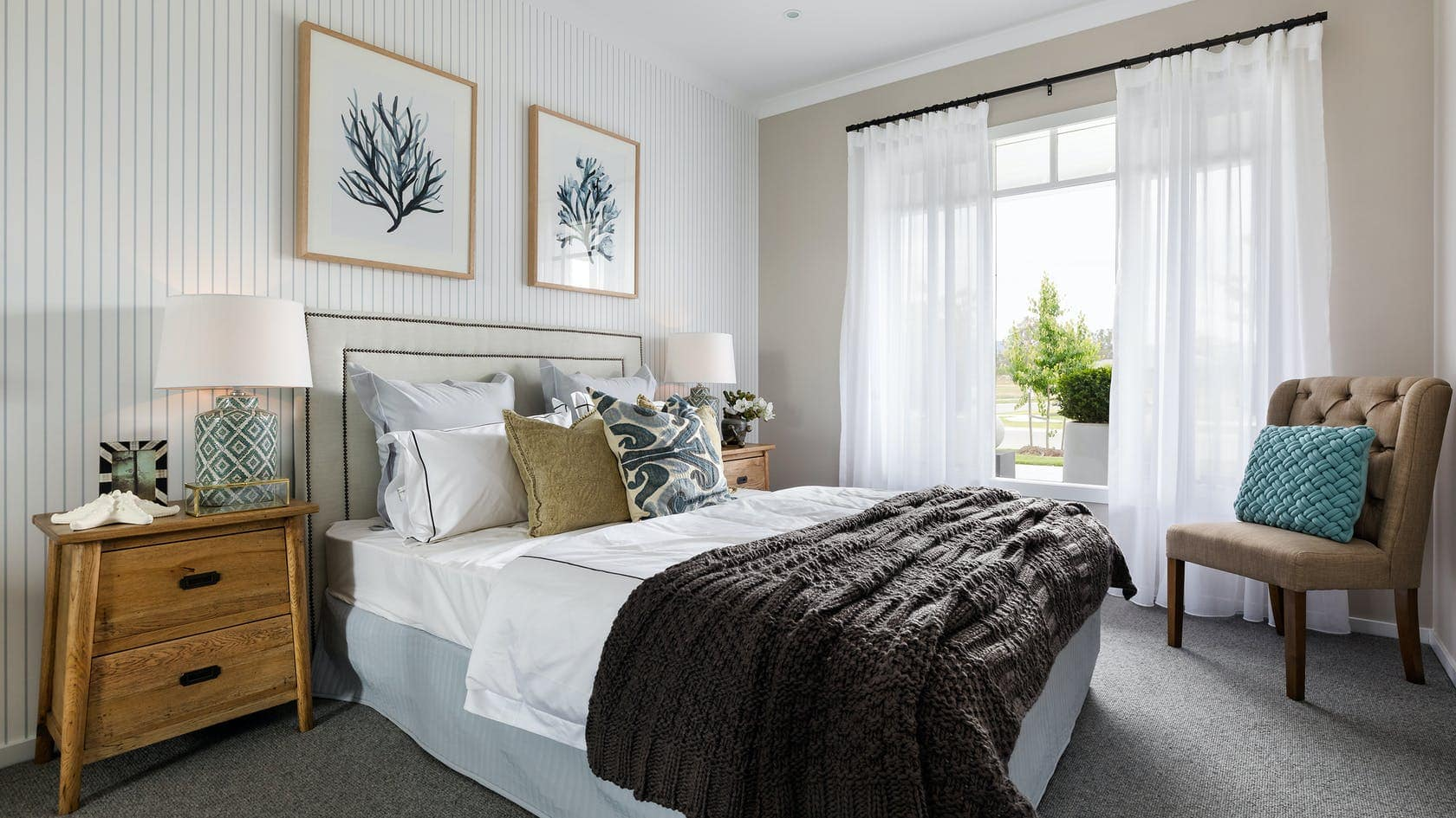 hamptons bedroom with striped wallpaper and white sfold sheer curtain on black track