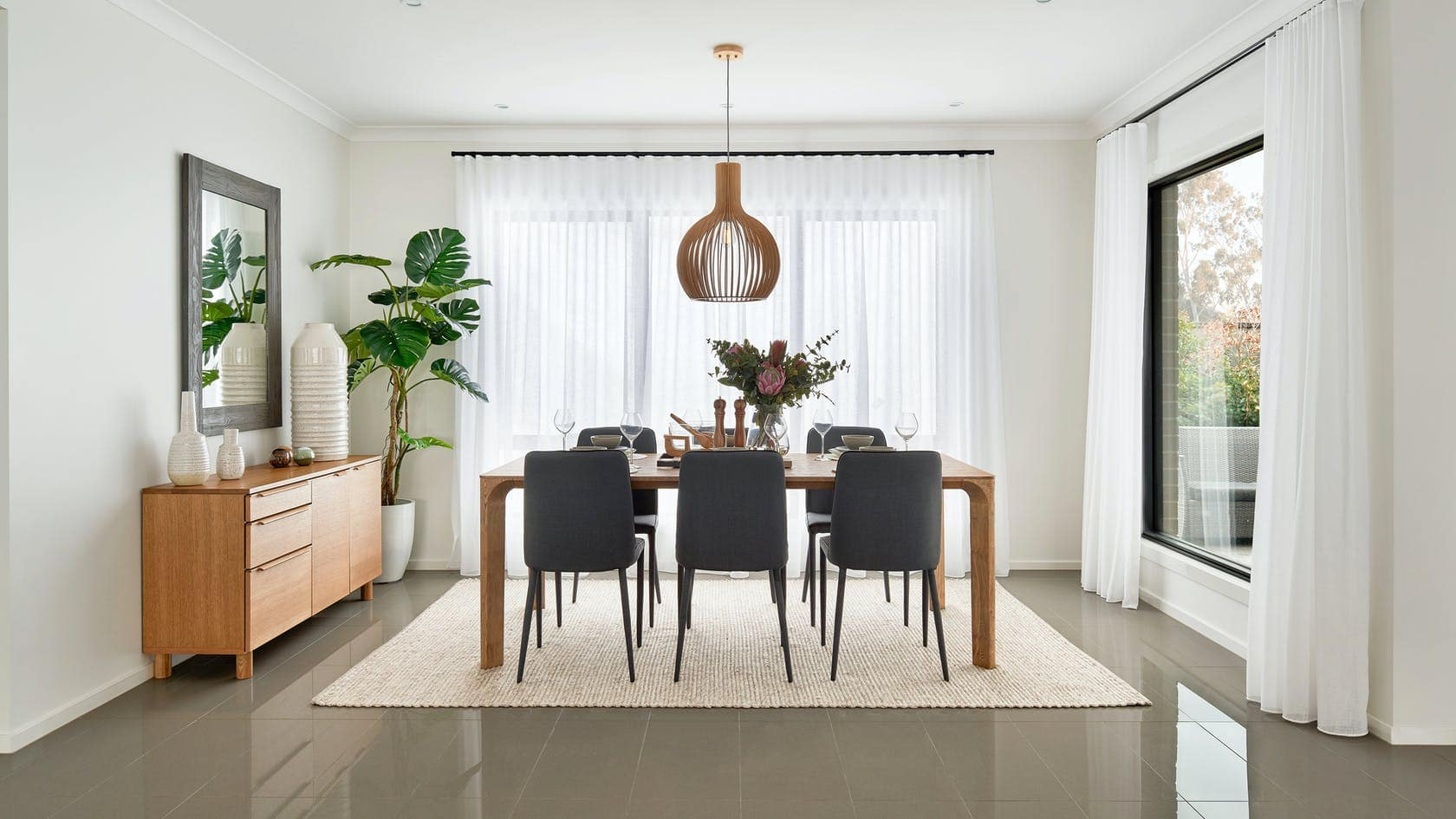 modern white dining room with white s fold sheer curtains on black track
