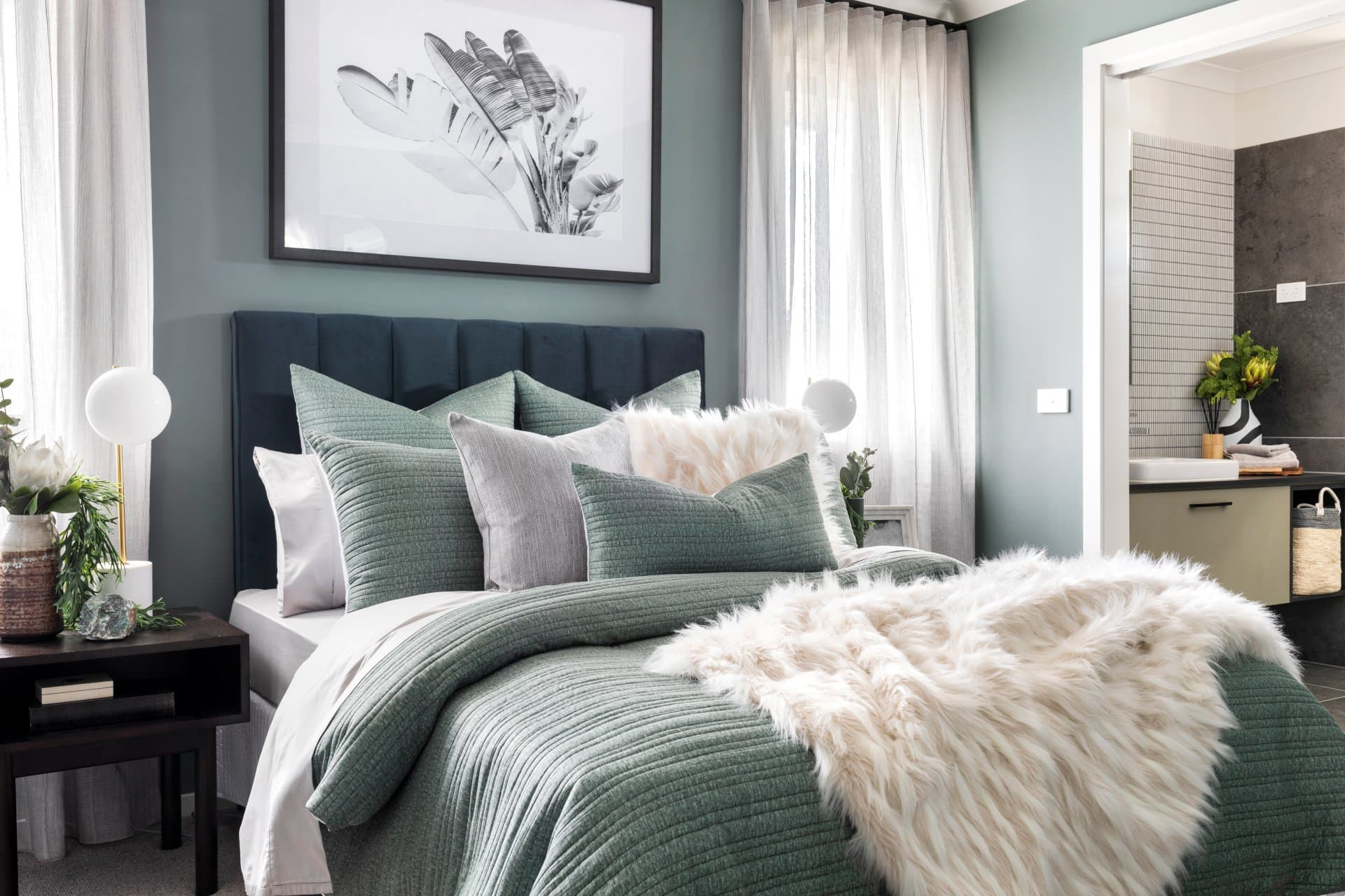 olive green bedding set with white faux fur throw and cushions from lorraine lea