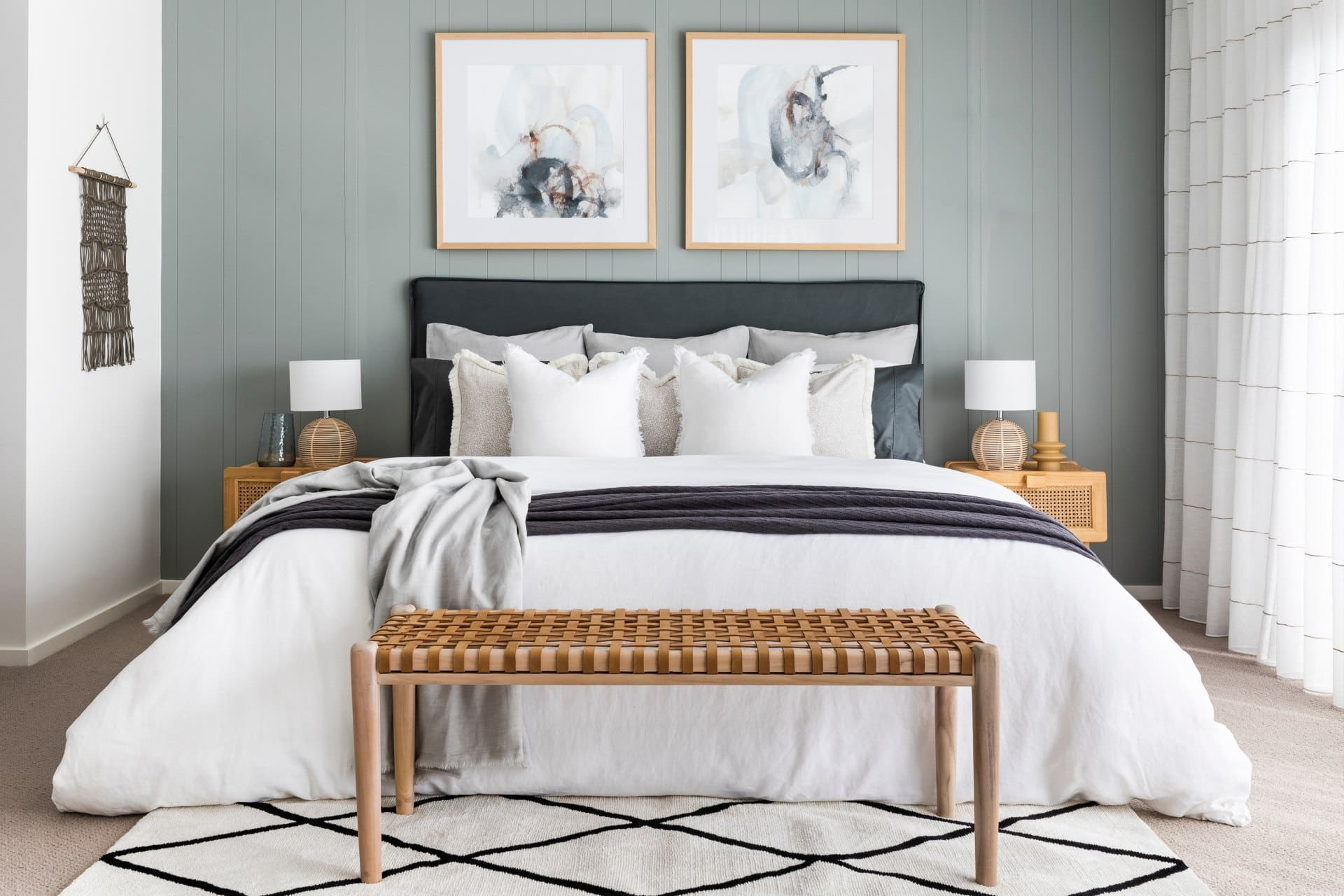 sage green bedroom styling with white linen quilt cover set and woven leather bench seat