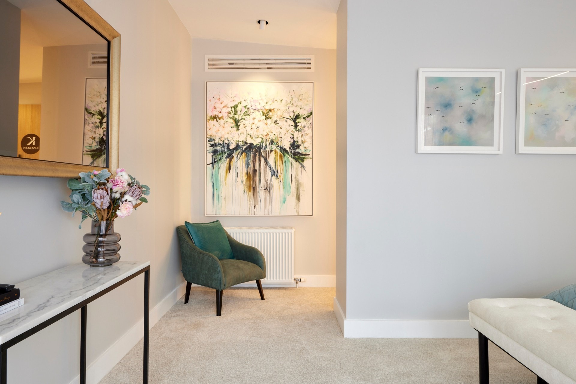 the block 2021 josh and luke master bedroom armchair and artwork