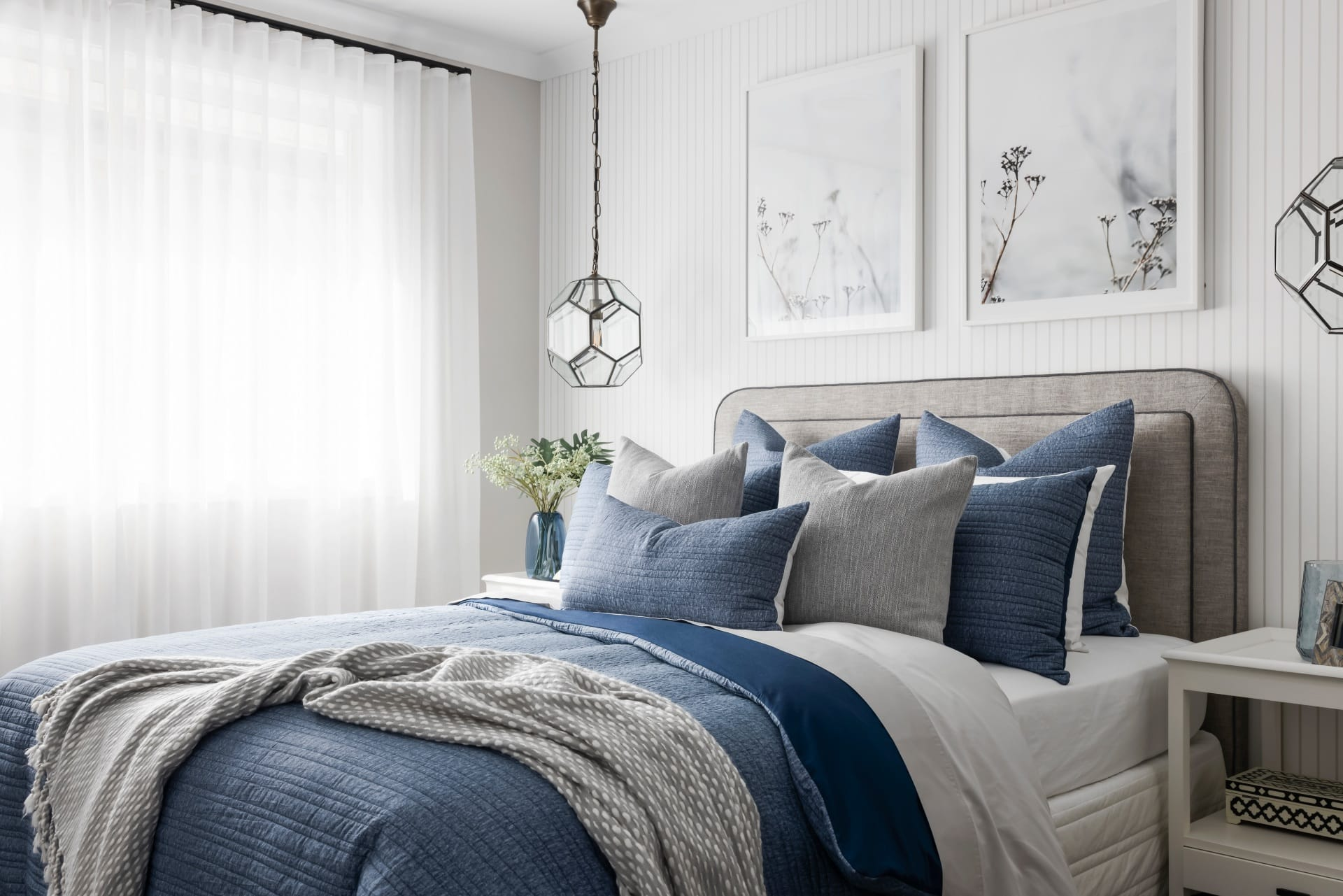 blue and white hamptons bedroom styling with glass hamptons pendant lights and stripe wallpaper