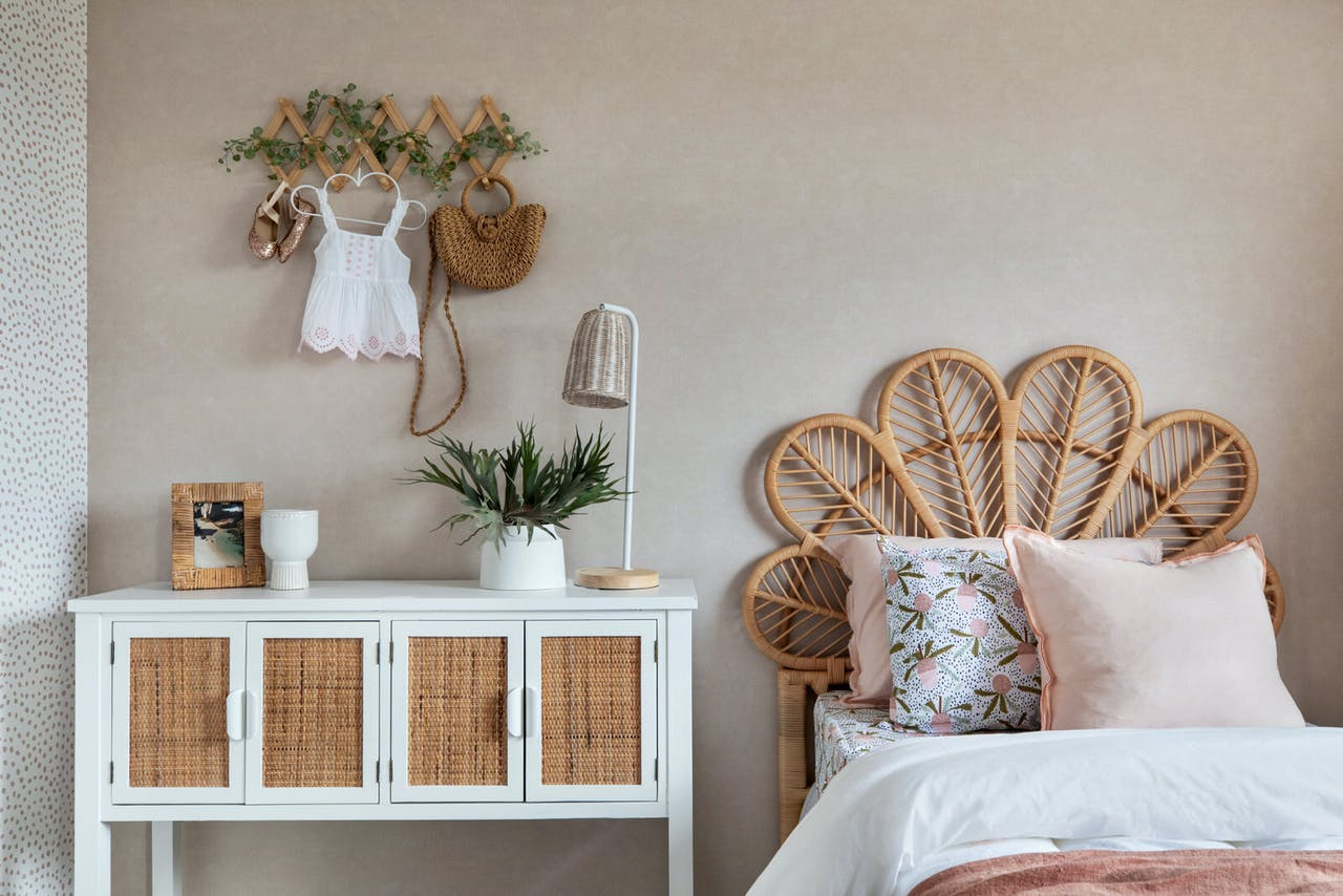 bohemian girls bedroom with single rattan bed styled with white quilt cover set