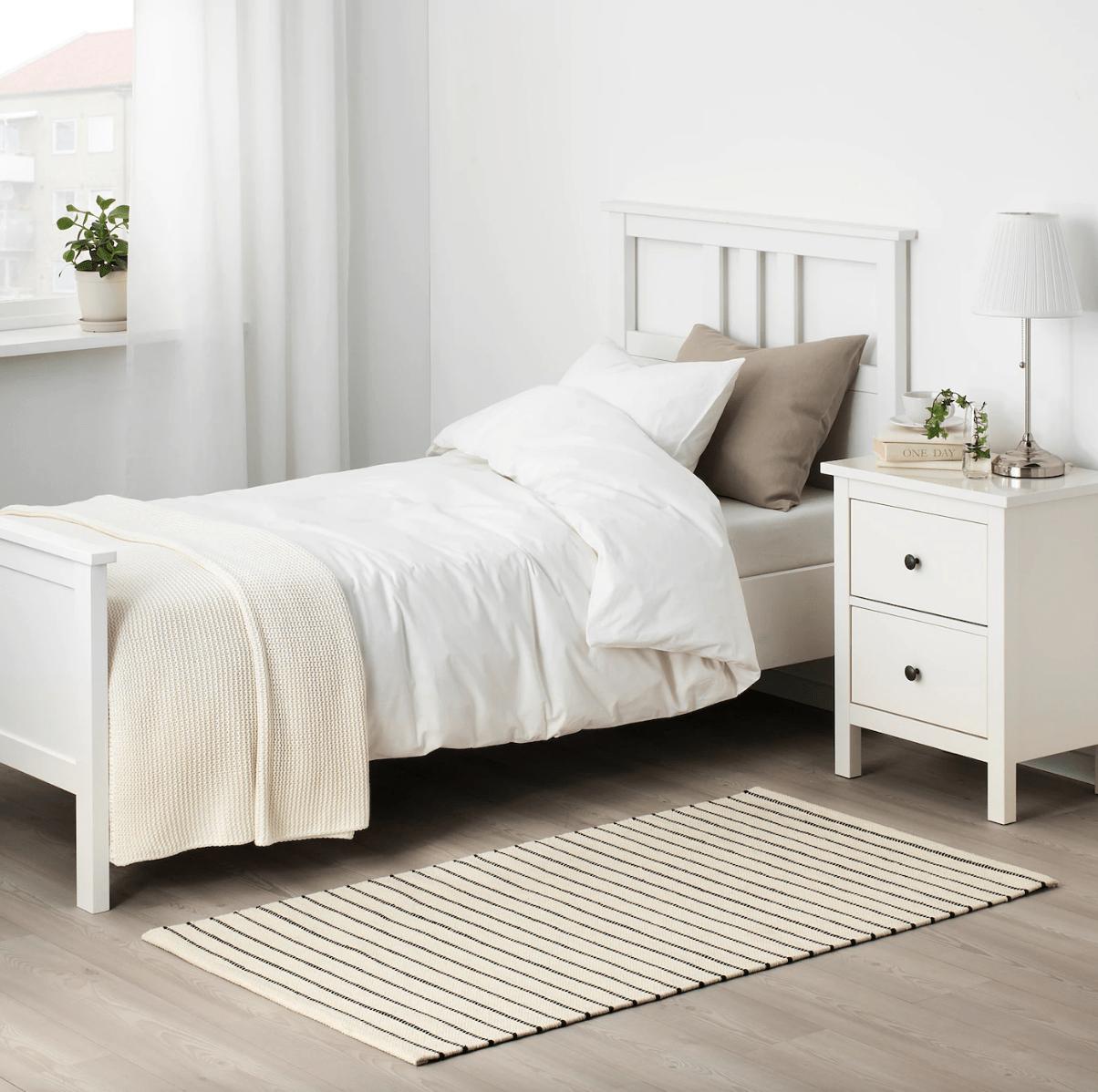 ikea hall runner rug beside bed in bedroom