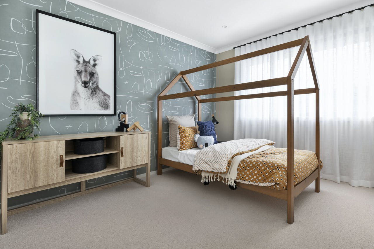 kids bedroom styling with four poster house bed timber