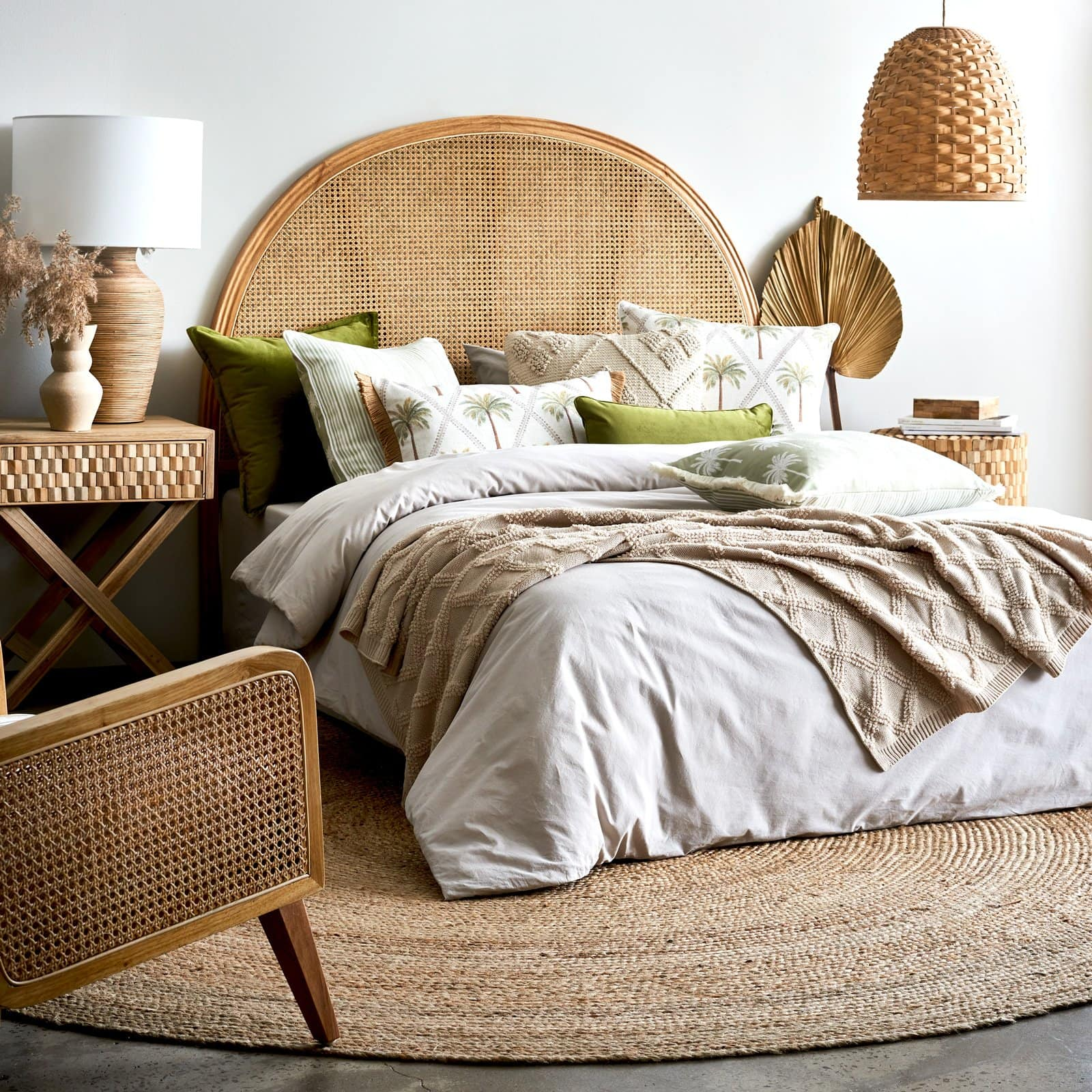 large round jute rug under rattan bed in bedroom