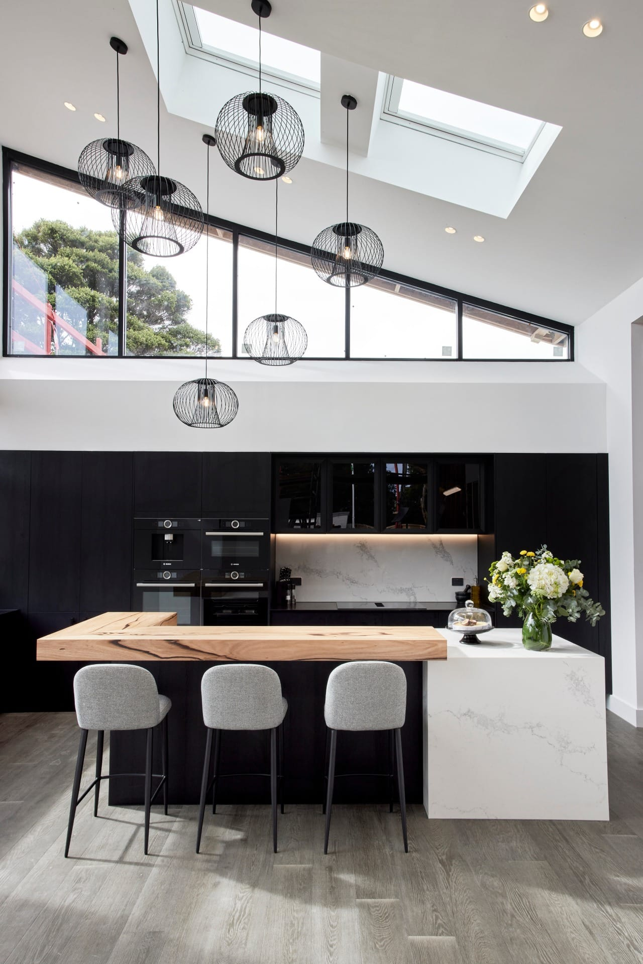 the block 2021 josh and luke black and white kitchen with timber benchtop and vaulted ceiling
