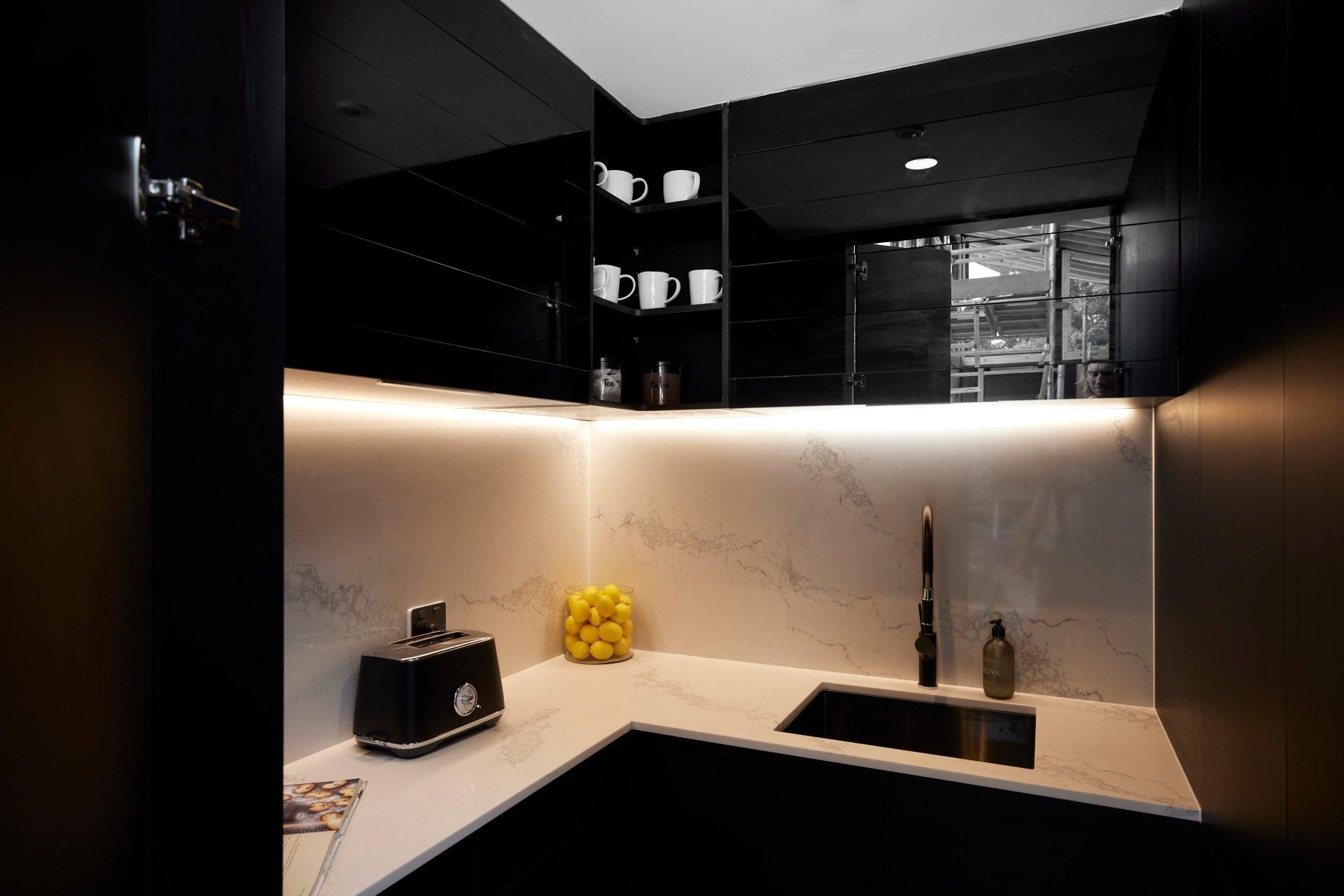 the block 2021 josh and luke kitchen black butlers pantry stone countertop