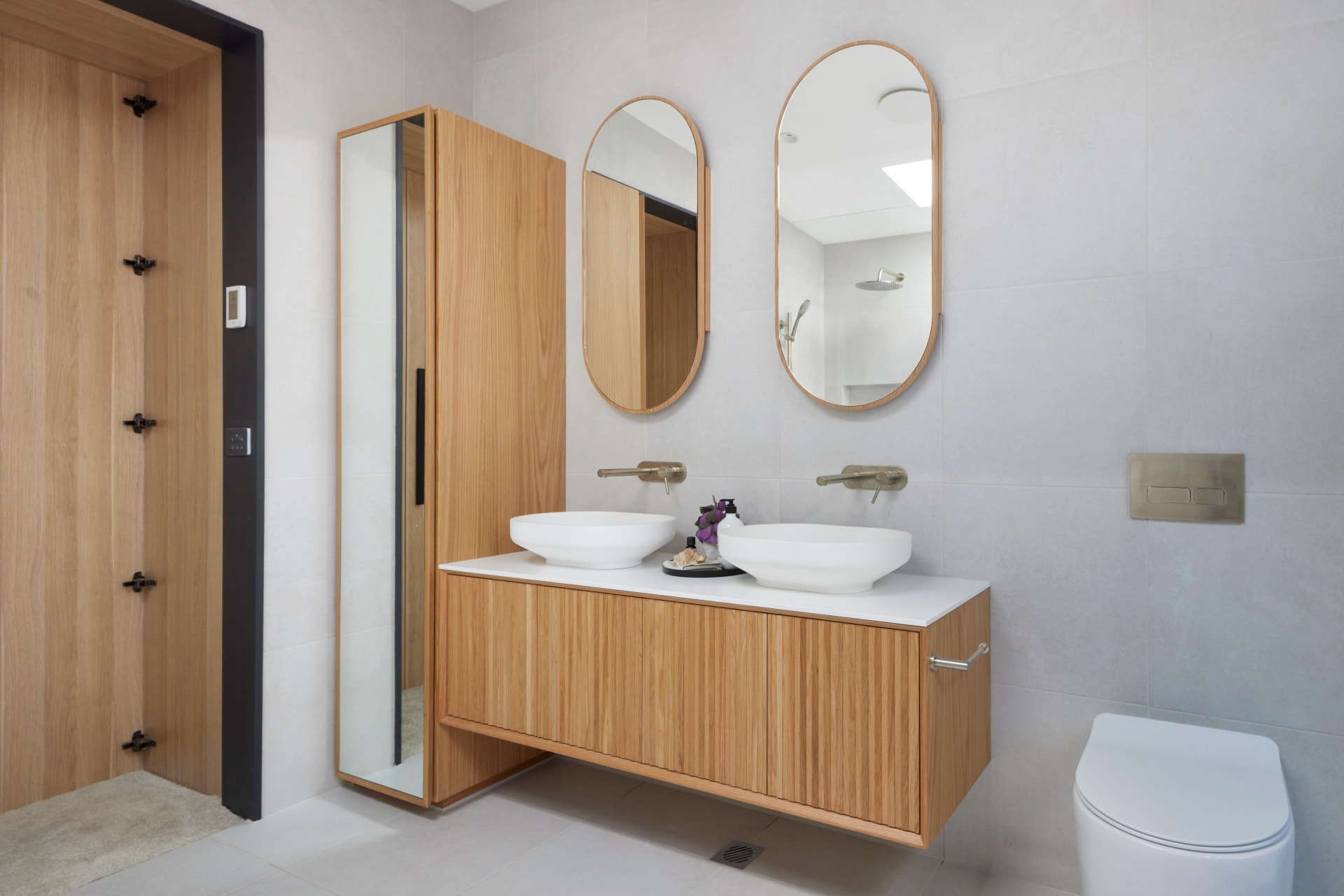 the block 2021 josh and luke master ensuite light timber floating vanity with double arch mirrors