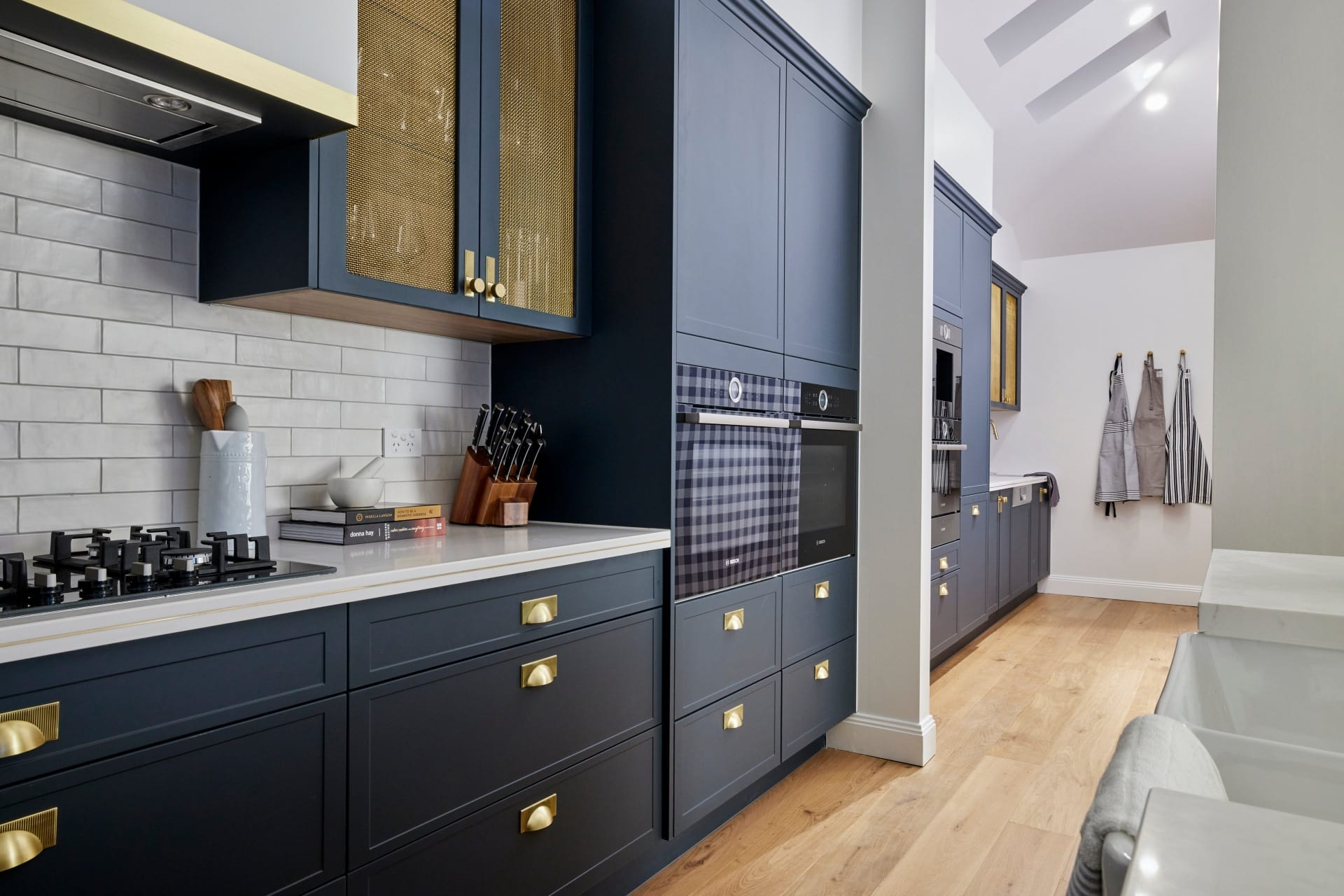 the block 2021 kirsty and jesse hamptons kitchen butlers pantry blue cabinets brass handles subway tiles