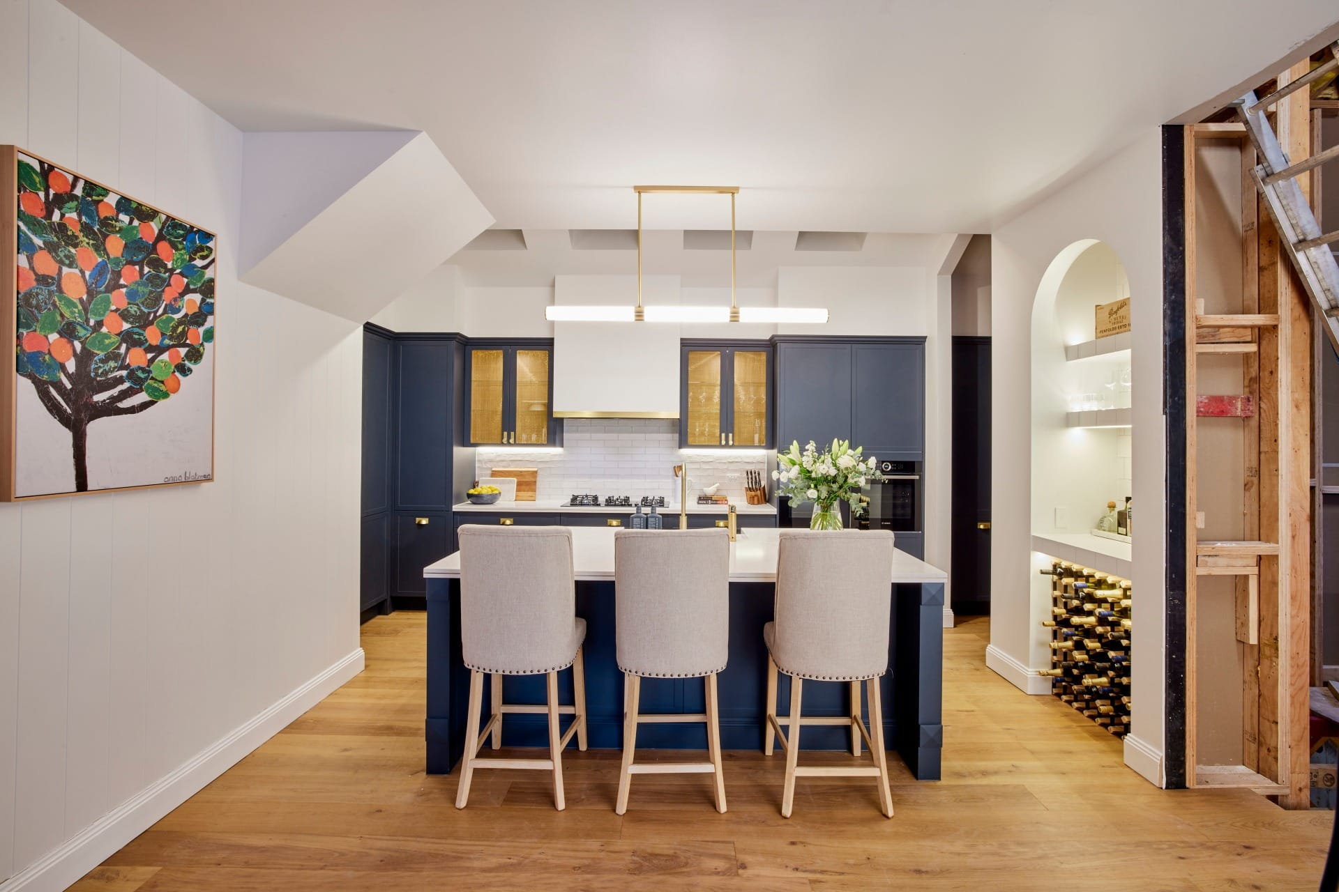 the block 2021 kirsty and jesse hamptons kitchen with blue cabinets and brass handles