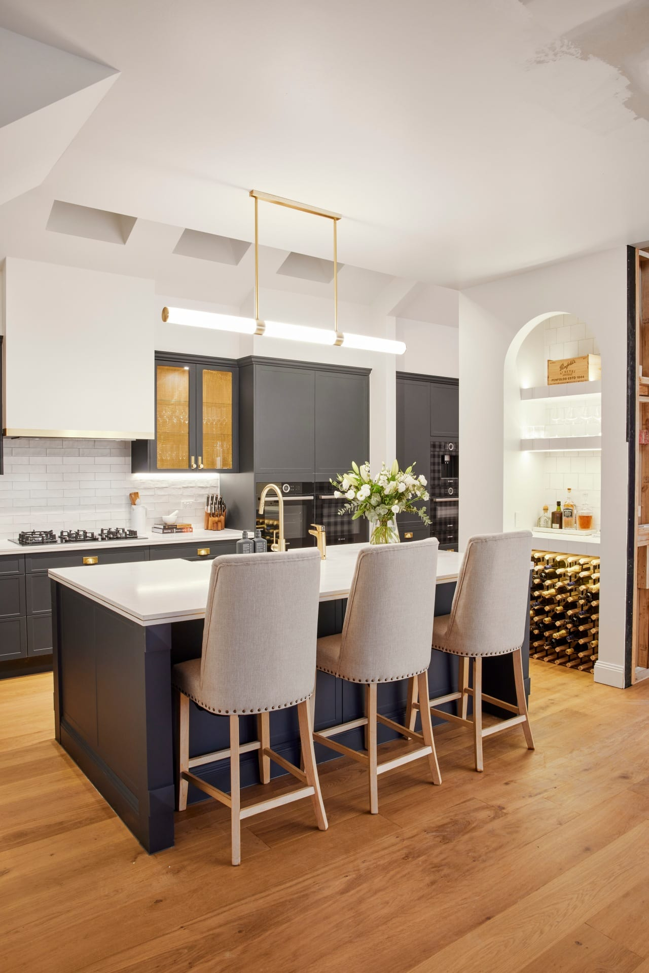 the block 2021 kirsty and jesse kitchen hamptons style with navy blue and brass