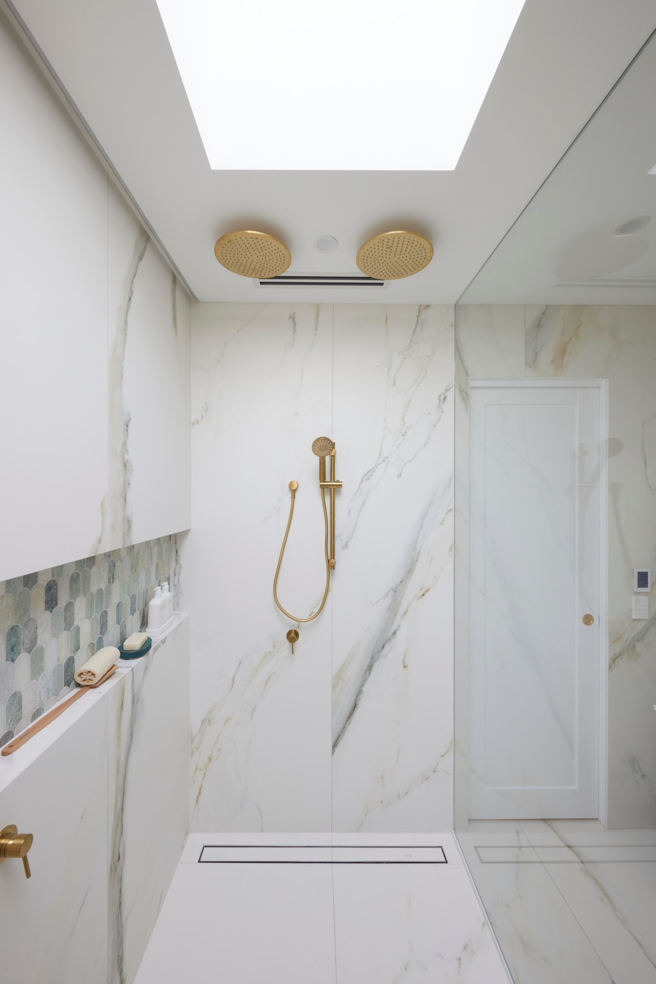 the block 2021 mitch and mark master ensuite shower with brass double shower heads