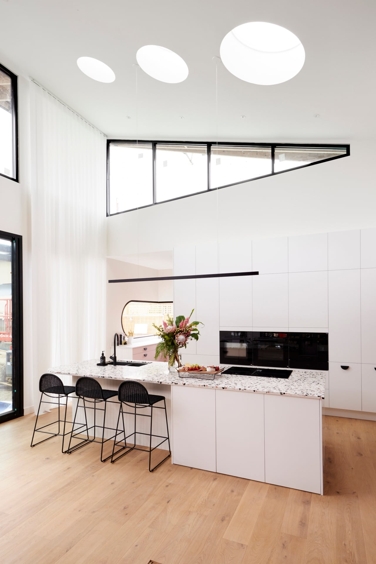 the block 2021 tanya and vito kitchen with vaulted ceiling and round skylights