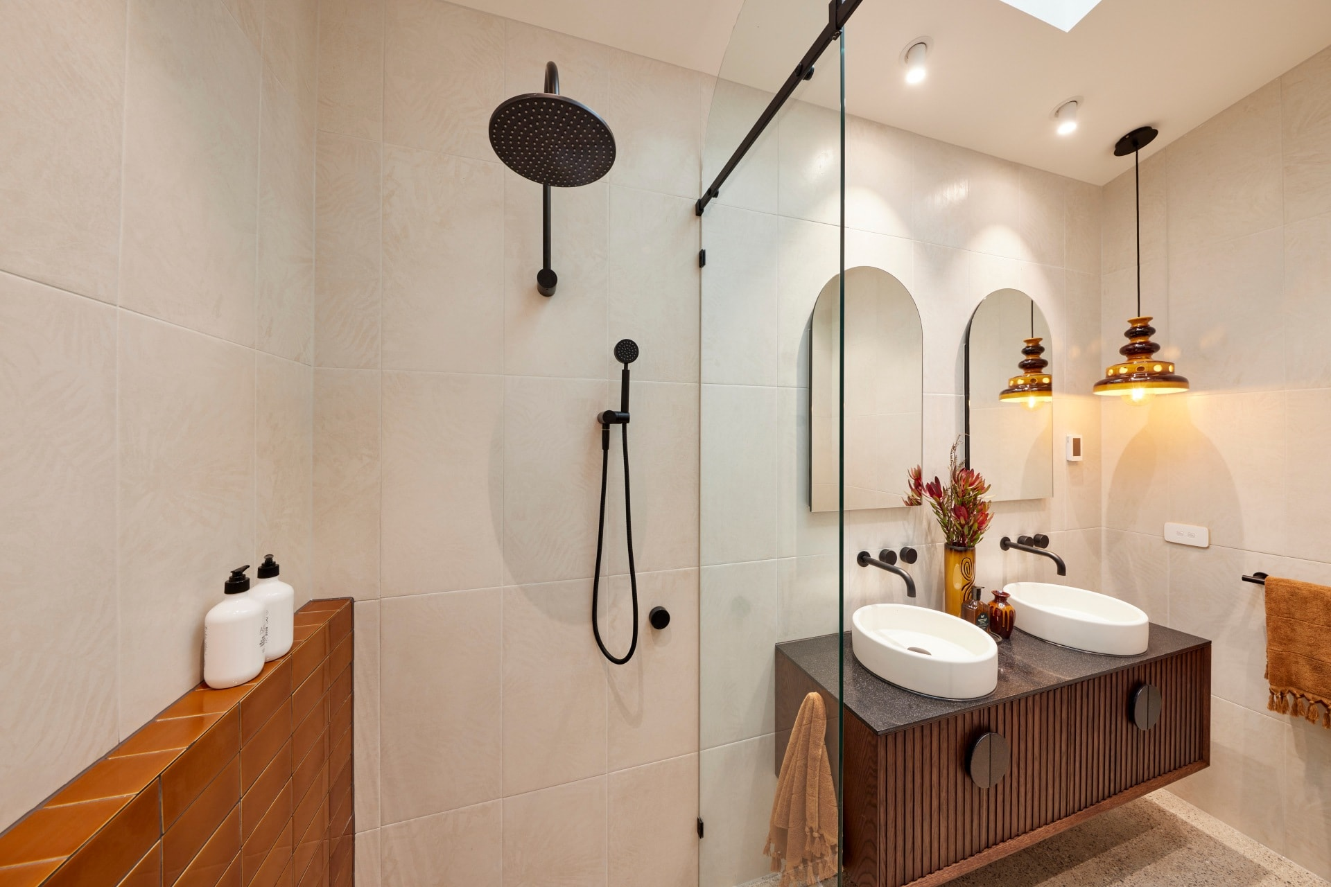 the block 2021 tanya and vito master ensuite brown wall tiles and brown floating zuster vanity