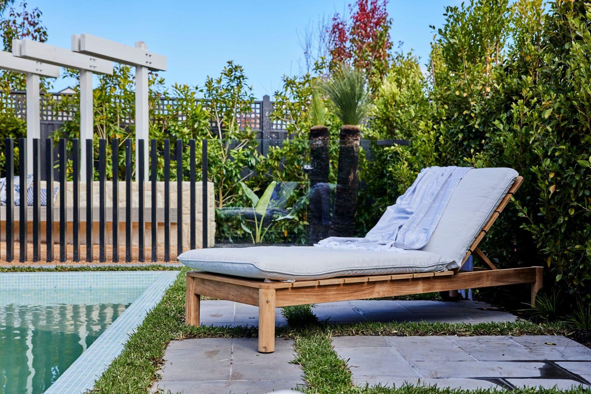 the block 2021 kristy and jesse backyard pool area sun lounger