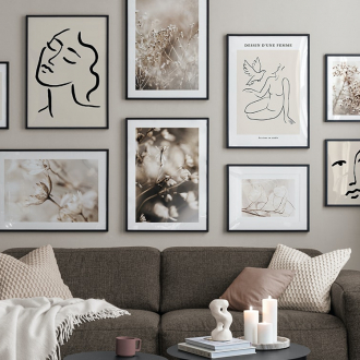 black and white gallery wall of art in living room with beige walls