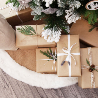 brown paper christmas wrapping scandi christmas decorations with coloured ribbon presents under tree