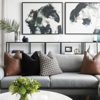 contemporary urban living room design with grey sofa tan leather cushions and marble coffee table