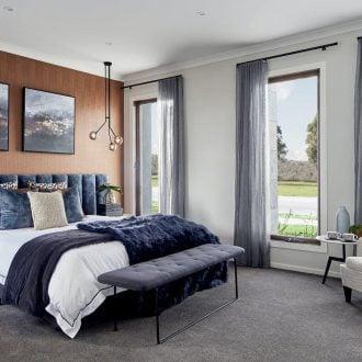 extra wide navy blue headboard in moody master bedroom