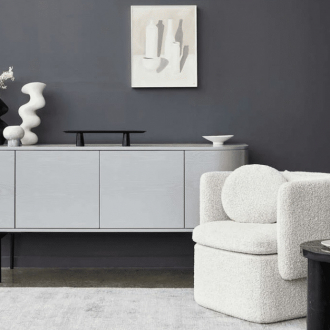 globewest boucle armchair in luxe living room with white sideboard