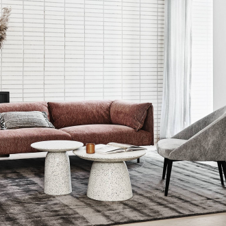 globewest terrazzo side table and terrazzo coffee table with velvet burgundy sofa