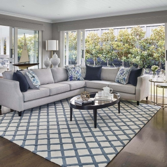 hamptons style living room with blue and white diamond hamptons rug