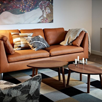 ikea stockholm leather sofa in moody urban living room